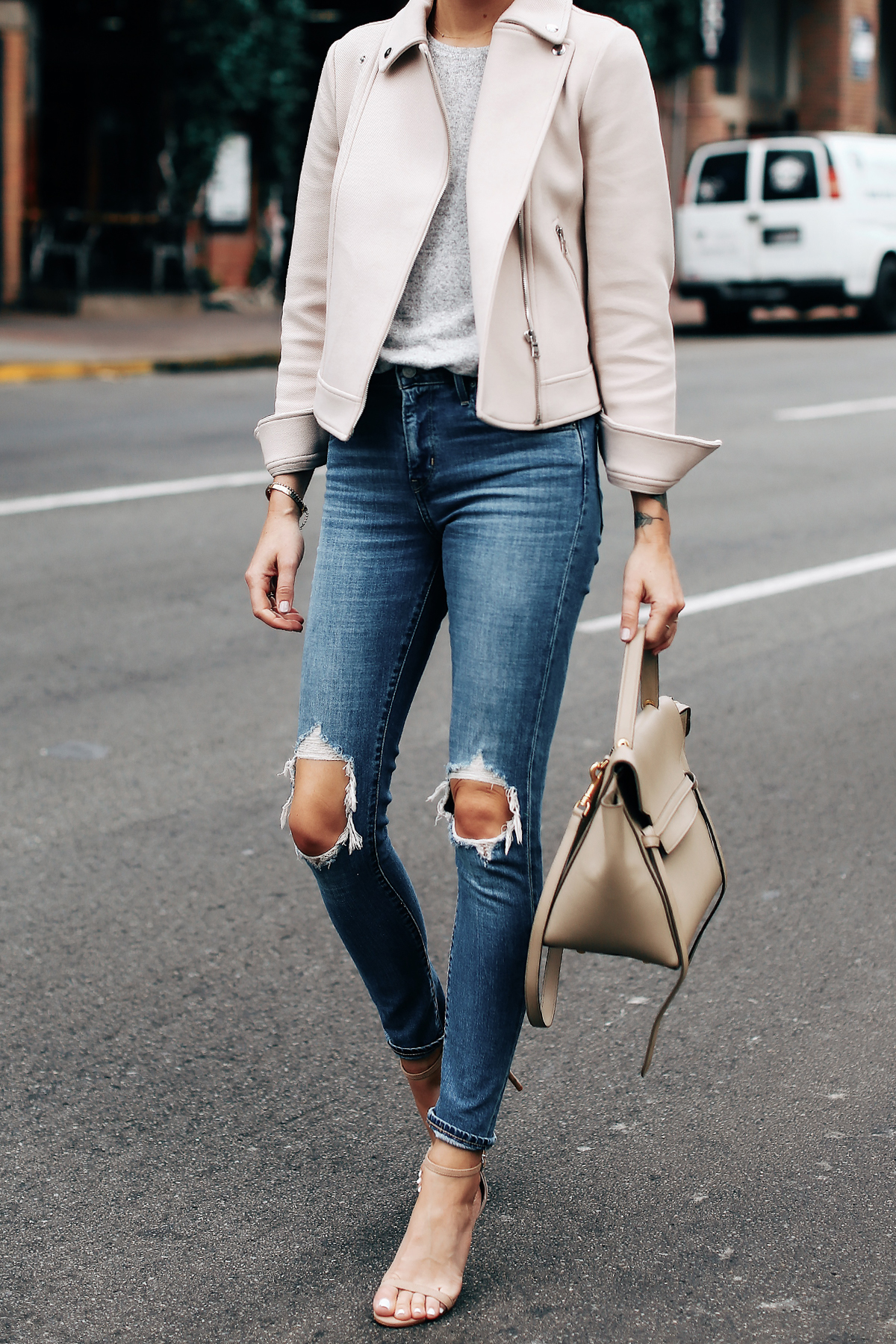 Woman Wearing Ann Taylor Blush Moto Jacket Grey Top Levis 721 Ripped Jeans Nude Ankle Strap Heels Celine Mini Belt Bag Fashion Jackson San Diego Fashion Blogger Street Style