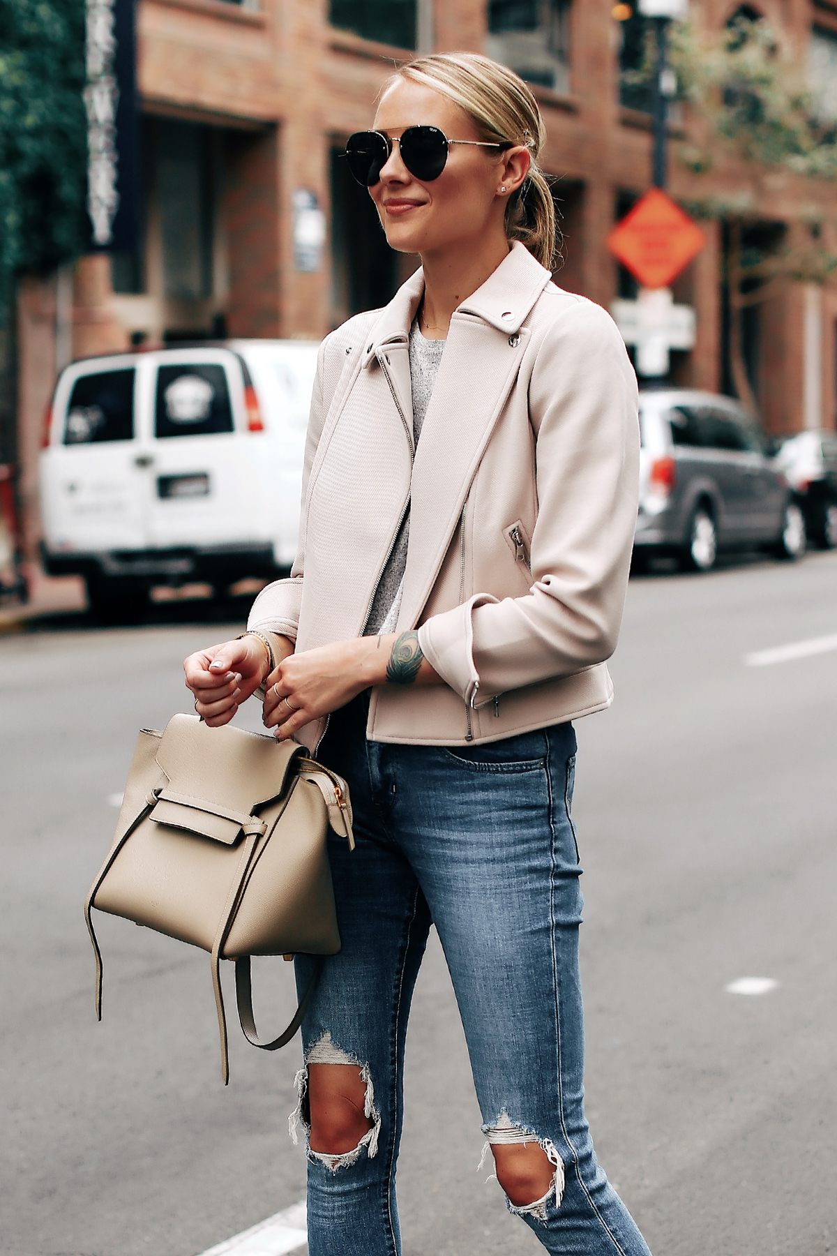 Blonde Woman Wearing Ann Taylor Blush Moto Jacket Levis 721 Ripped Jeans Celine Mini Belt Bag Aviator Sunglasses Fashion Jackson San Diego Fashion Blogger Street Style