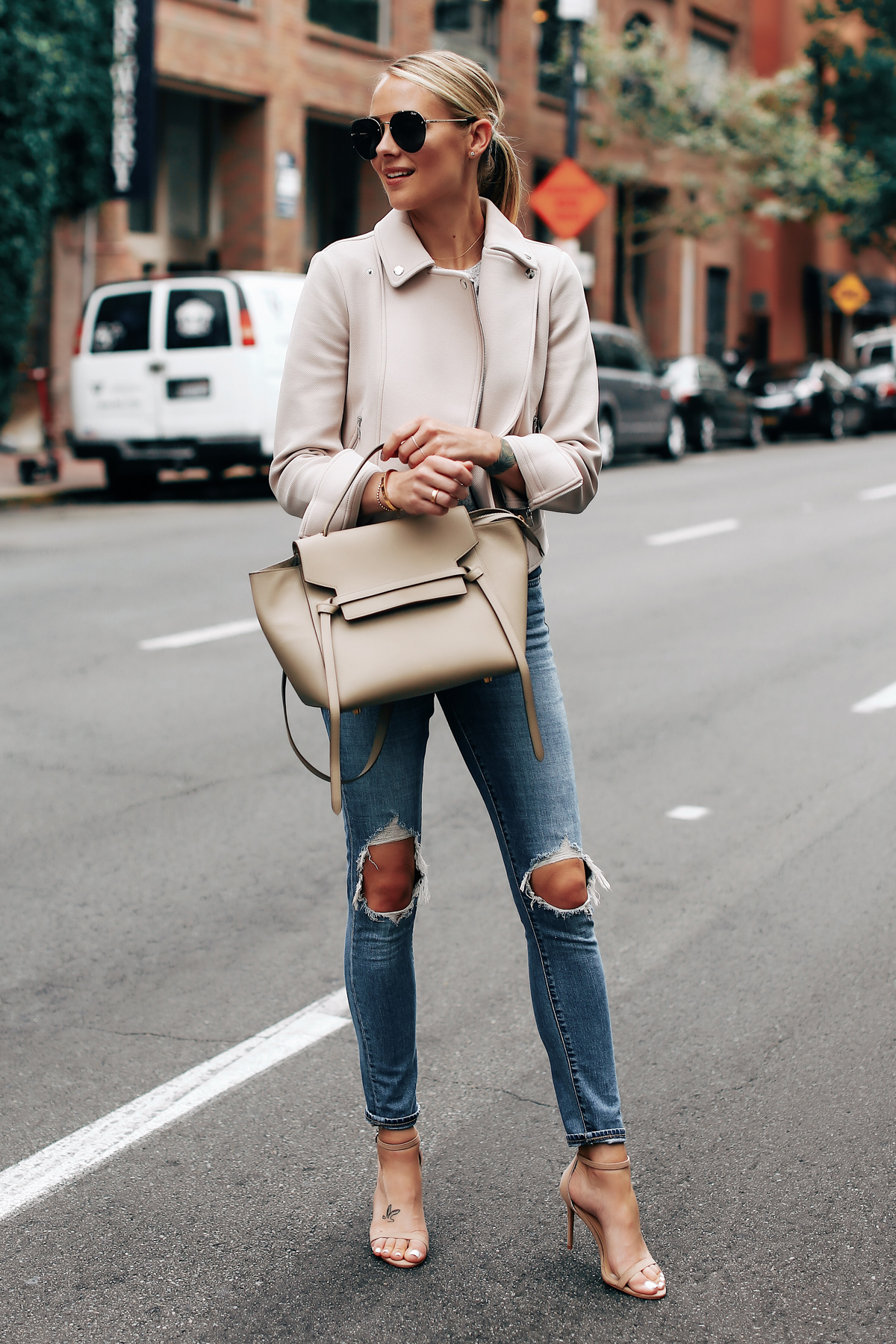 Blonde Woman Wearing Ann Taylor Blush Moto Jacket Levis 721 Ripped Jeans Nude Ankle Strap Heels Celine Mini Belt Bag Aviator Sunglasses Fashion Jackson San Diego Fashion Blogger Street Style
