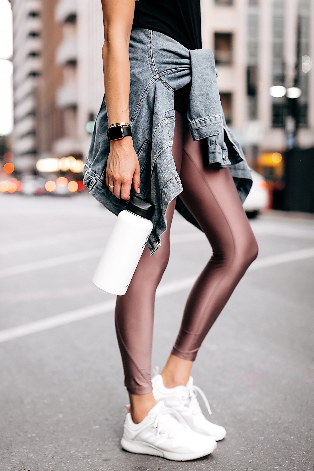 Woman Wearing Athleisure Workout Outfit Nike Mauve Leggings Denim Jacket Adidas EdgeBounce Running Shoes Apple Watch Hydro Flask Water Bottle White Fashion Jackson San Diego Fashion Blogger Street Style