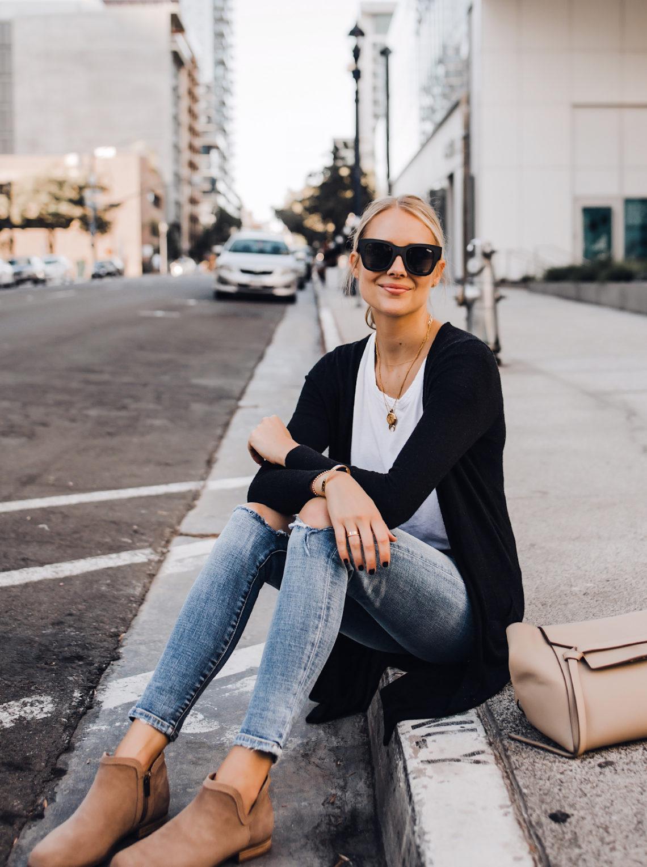 Blonde Woman Wearing Black Cardigan White Tshirt Ripped Skinny Jeans Celine Mini Belt Bag Uggs Koolaburra Tan Booties Fashion Jackson San Diego Fashion Blogger Street Style