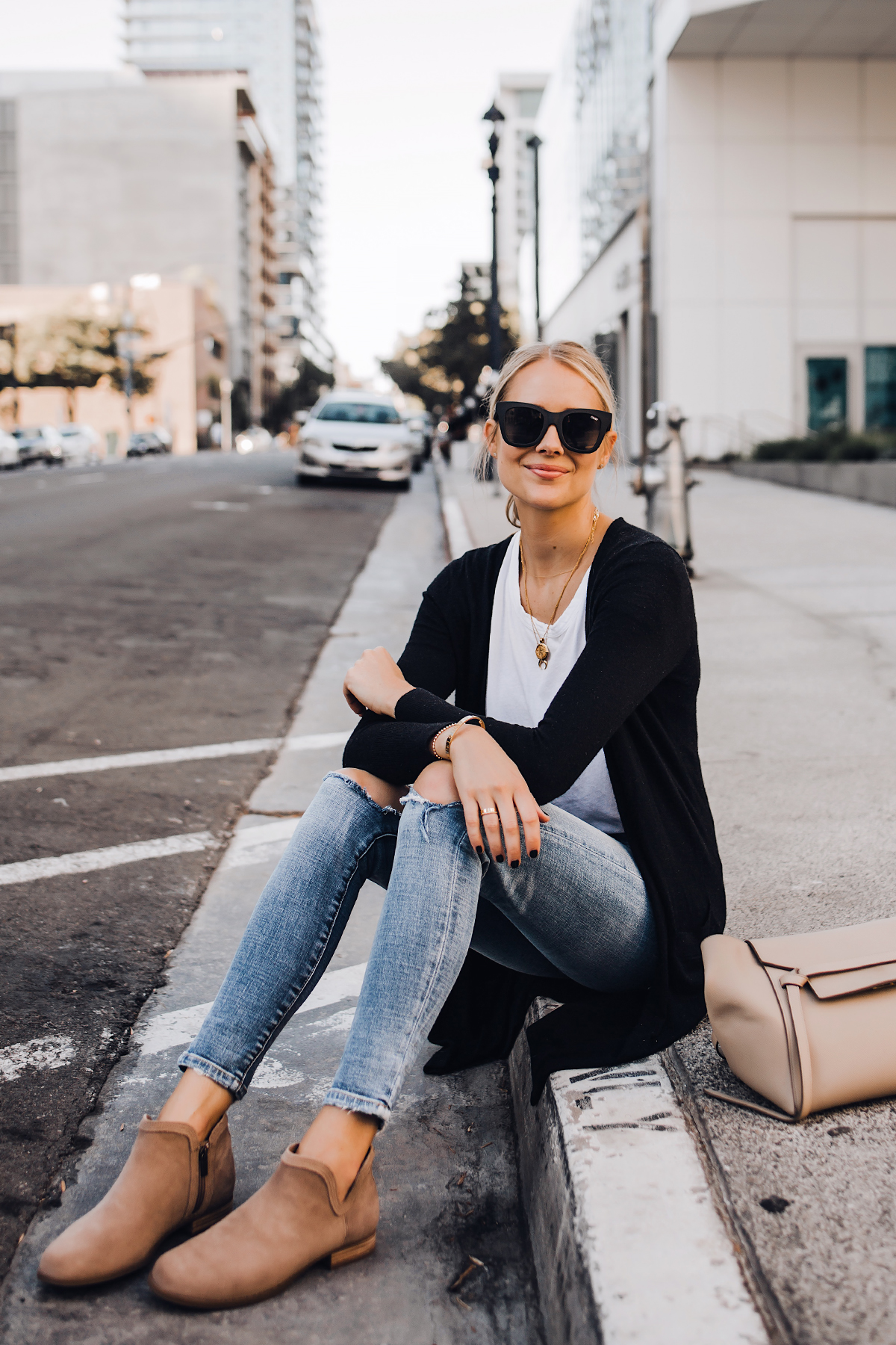 Blonde Woman Wearing Black Cardigan White Tshirt Ripped Skinny Jeans Celine Mini Belt Bag Uggs Koolaburra Tan Booties Fashion Jackson San Diego Fashion Blogger Street Style