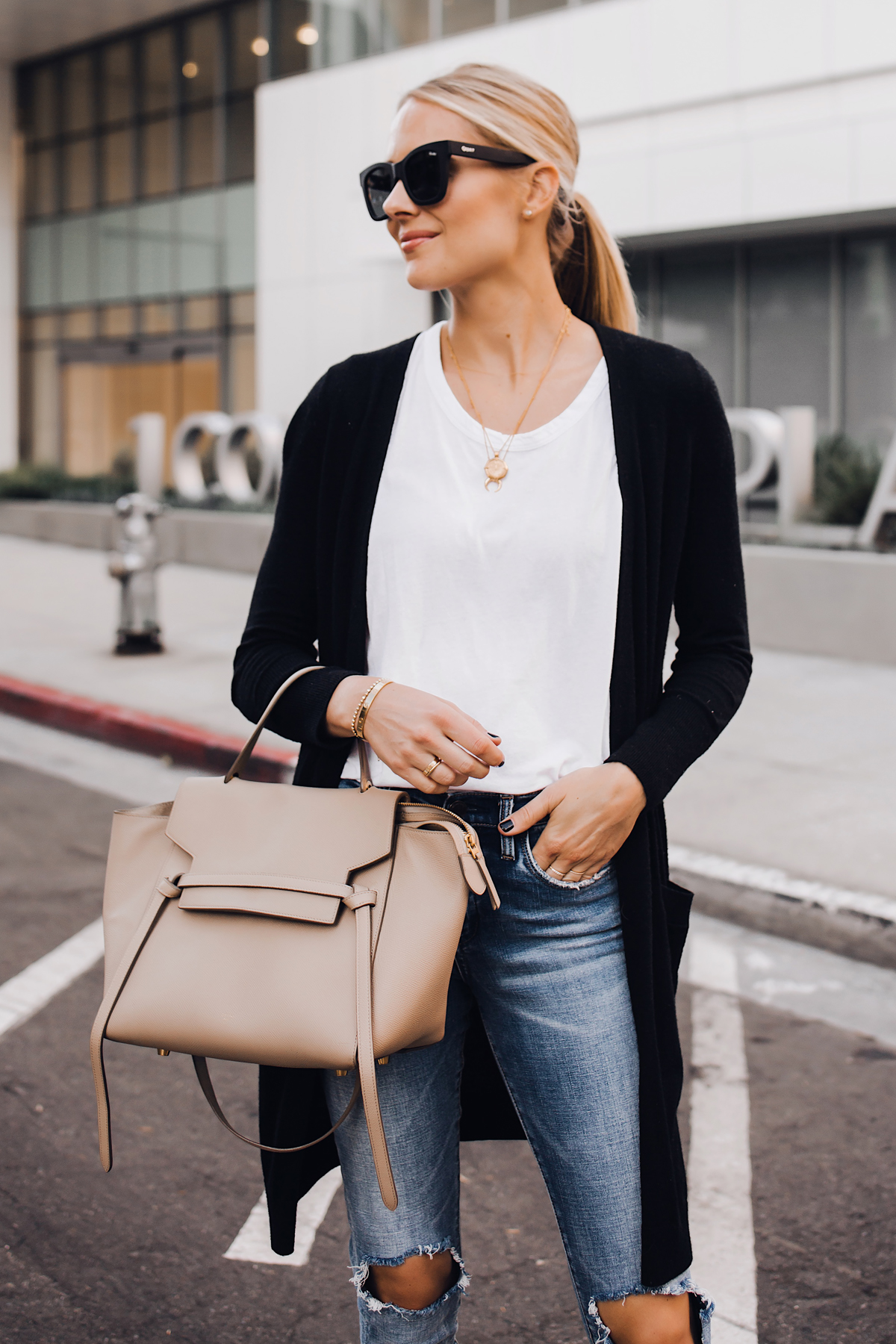 Blonde Woman Wearing Black Cardigan White Tshirt Ripped Skinny Jeans Celine Mini Belt Bag Fashion Jackson San Diego Fashion Blogger Street Style