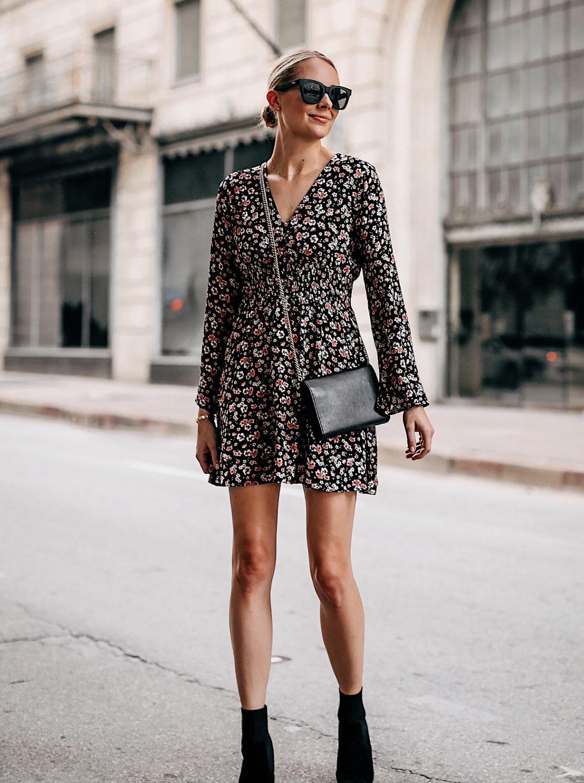 Blonde Woman Wearing Black Floral Long Sleeve Mini Dress Black Heeled Ankle Booties Gold Chain Black Crossbody Handbag Black Sunglasses Fashion Jackson San Diego Fashion Blogger Street Style