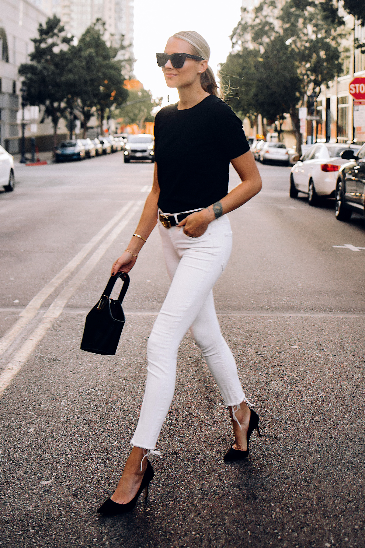 Blonde Woman Wearing Black Short Sleeve Sweater White Skinny Raw Hem Skinny Jeans Black Pumps Black Gucci Belt Fashion Jackson San Diego Fashion Blogger Street Style