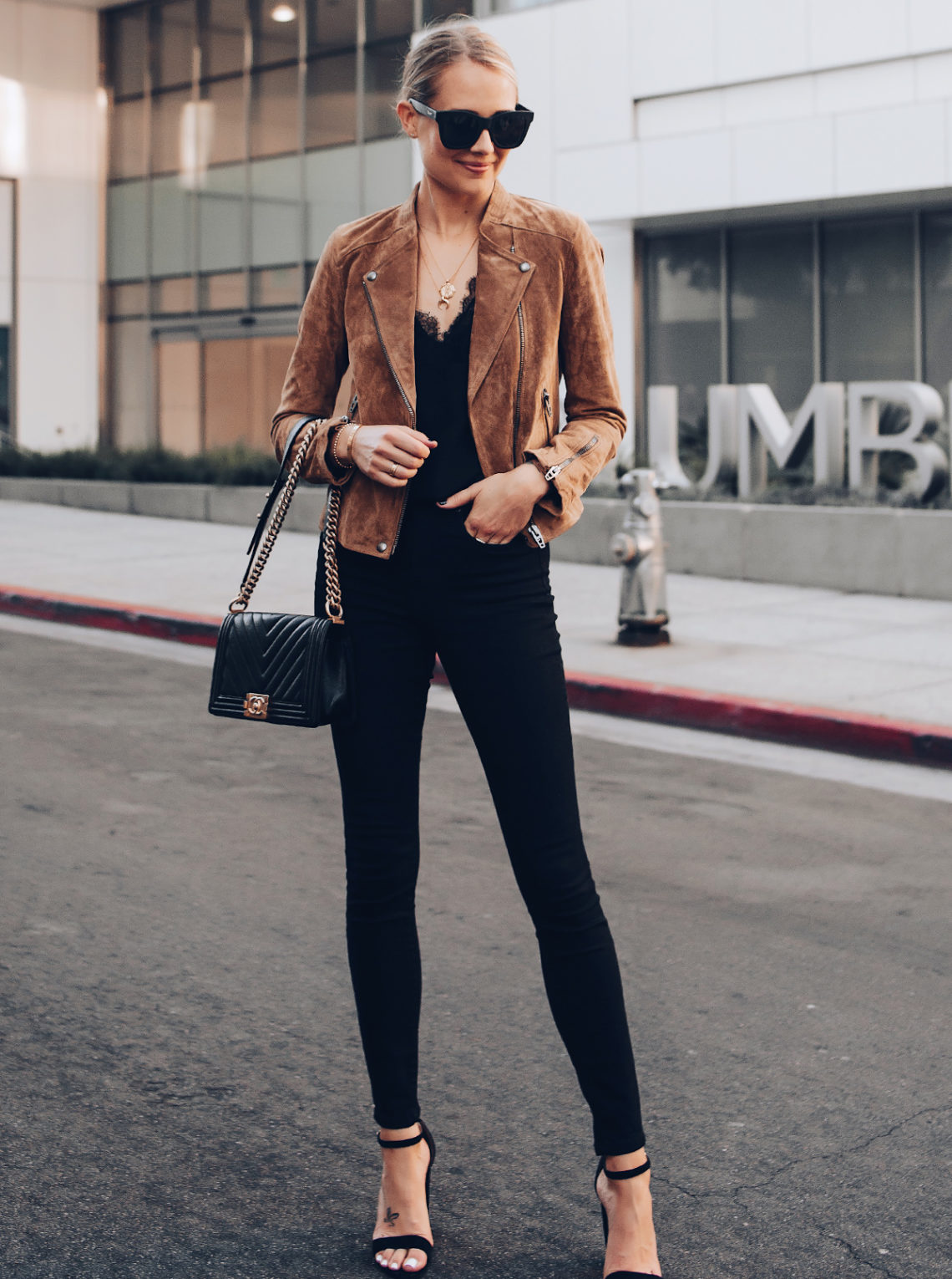 Blonde Woman Wearing Blanknyc Tan Suede Moto Jacket Black Lace Cami Everlane Black Skinny Jeans Black Ankle Strap Heeled Sandals Chanel Black Boy Bag Fashion Jackson San Diego Fashion Blogger Street Style