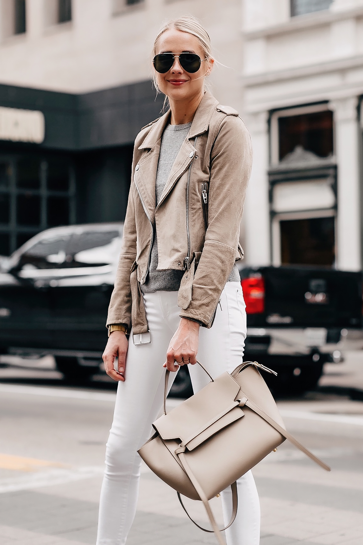 Blonde Woman Wearing Blanknyc Tan Suede Moto Jacket Tan Grey Sweater White Skinny Jeans Celine Taupe Mini Belt Bag Fashion Jackson San Diego Fashion Blogger Street Style