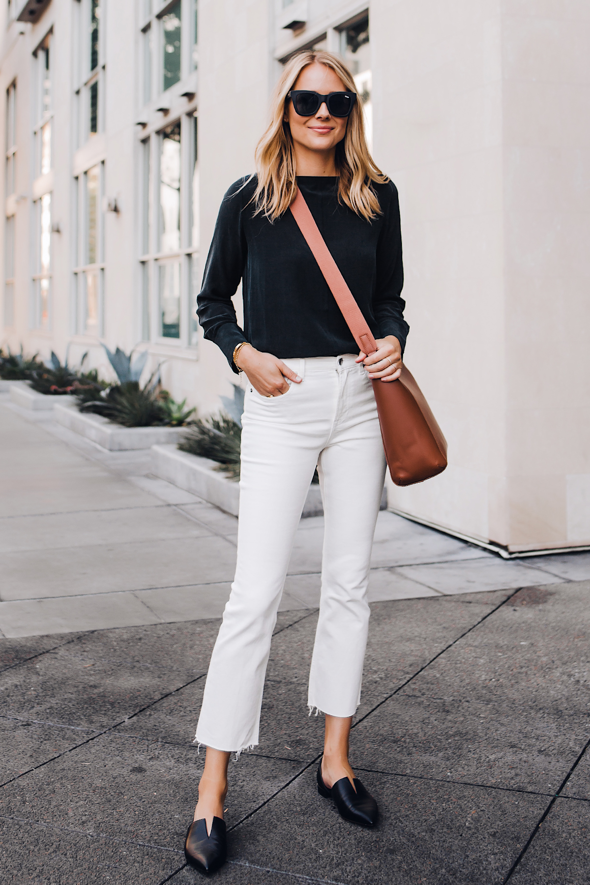 3a7f233325e Blonde Woman Wearing Everlane Black Silk Long Sleeve Top Everlane White  Cropped Jeans Everlane Brown Messenger