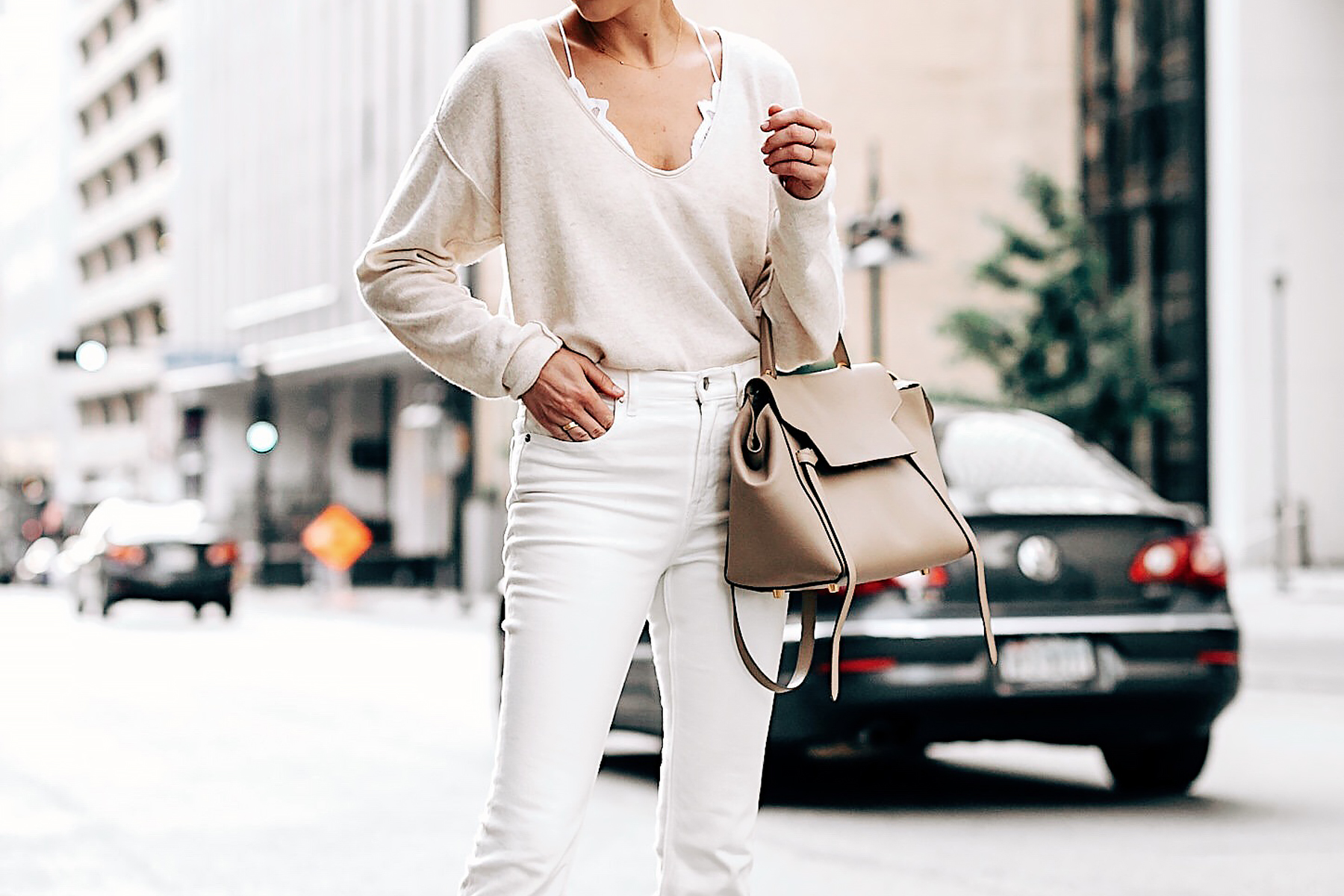 Woman Wearing Free People Ivory Cashmere Sweater White Lace Bralette Everlane White Jeans Celine Mini Belt Bag Fashion Jackson San Diego Fashion Blogger Street Style