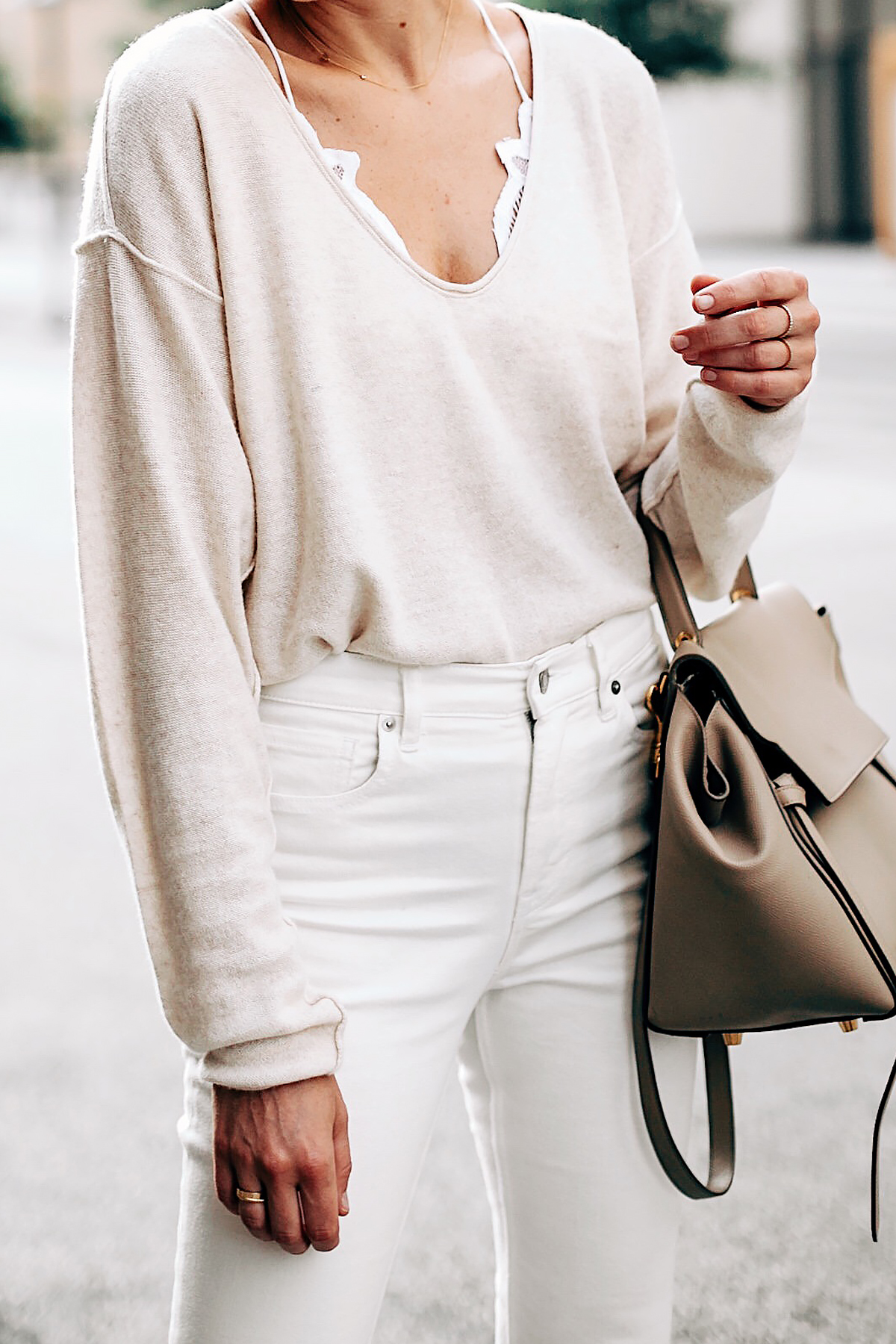 Blonde Woman Wearing Free People Ivory Cashmere Sweater White Lace Bralette Everlane White Jeans Celine Mini Belt Bag Fashion Jackson San Diego Fashion Blogger Street Style