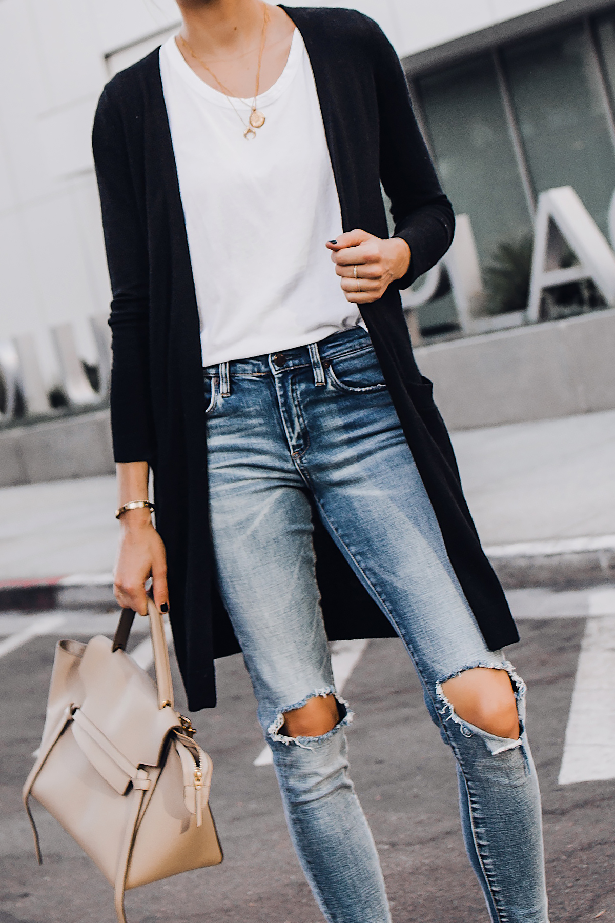Woman Wearing Long Black Cardigan White Tshirt Ripped Skinny Jeans Celine Mini Belt Bag Fashion Jackson San Diego Fashion Blogger Street Style