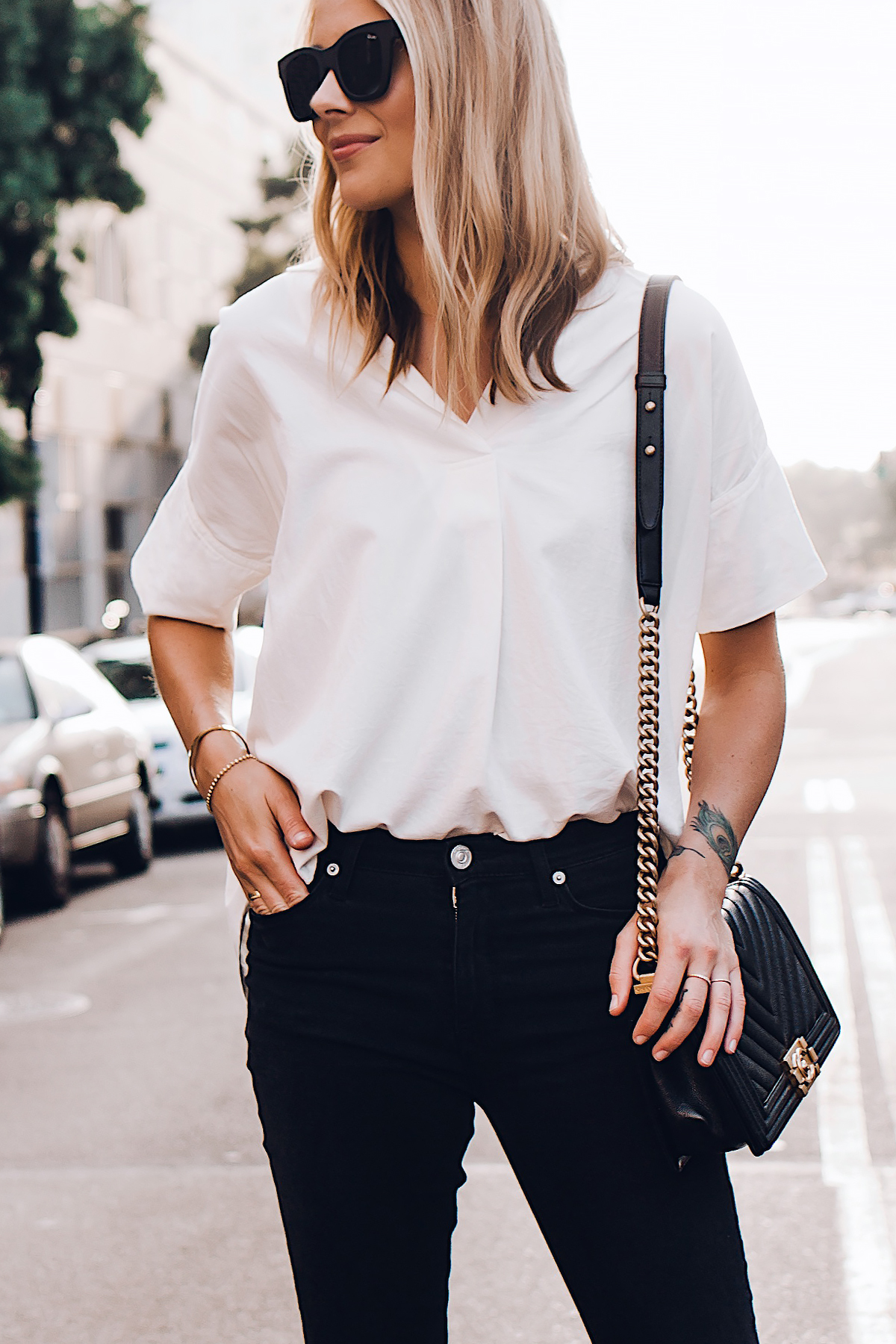 Blonde Woman Wearing Madewell Short Sleeve White Shirt Black Jeans Chanel Boy Bag Black Large Black Sunglasses Fashion Jackson San Diego Fashion Blogger Street Style