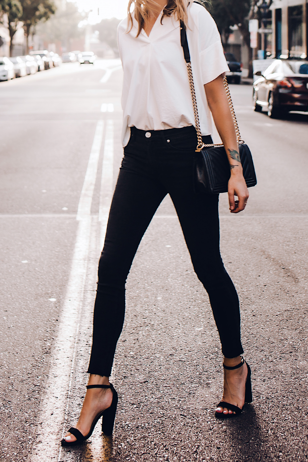 Woman Wearing Madewell Short Sleeve White Shirt Black Jeans Chanel Boy Bag Black Steve Madden Black Ankle Strap Heeled Sandals Fashion Jackson San Diego Fashion Blogger Street Style