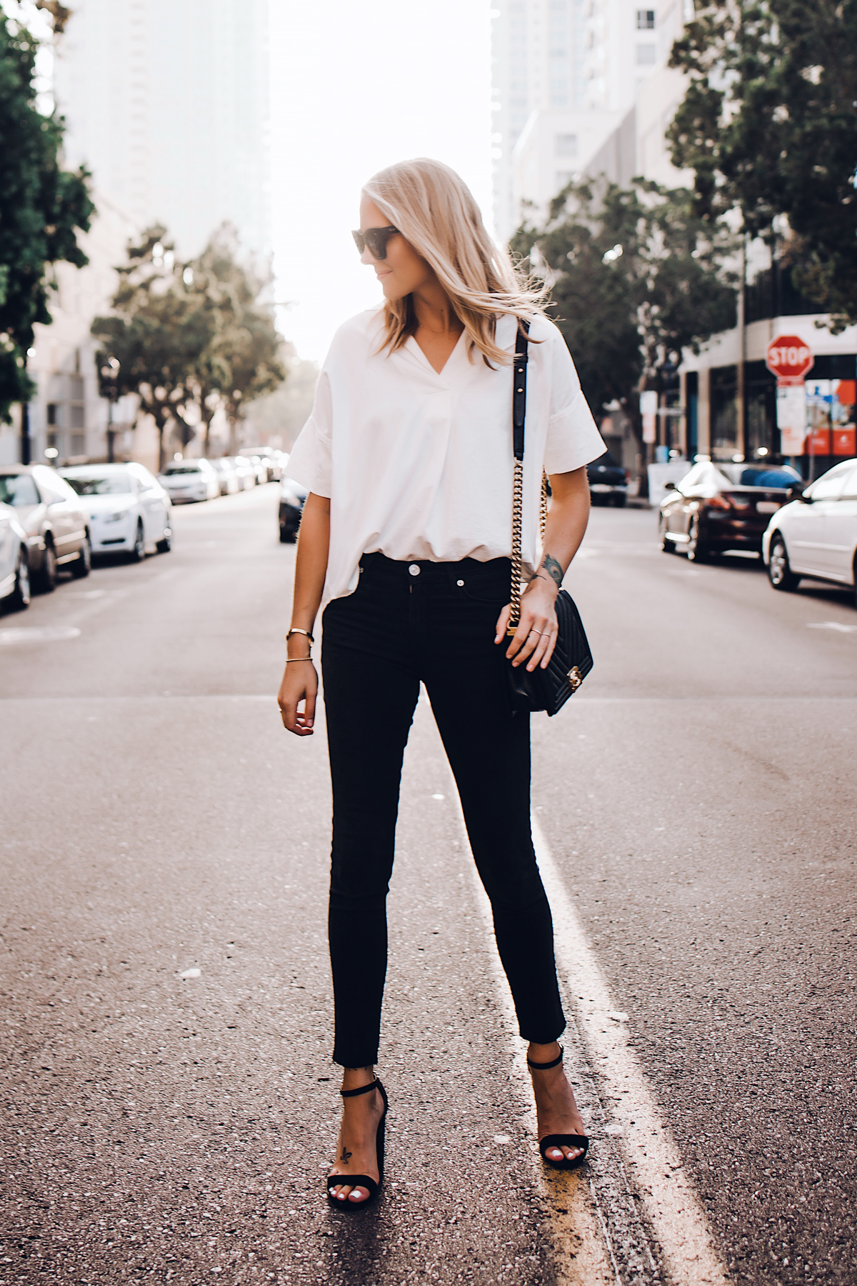 Blonde Woman Wearing Madewell Short Sleeve White Shirt Black Jeans Chanel Boy Bag Black Steve Madden Black Ankle Strap Heeled Sandals Fashion Jackson San Diego Fashion Blogger Street Style