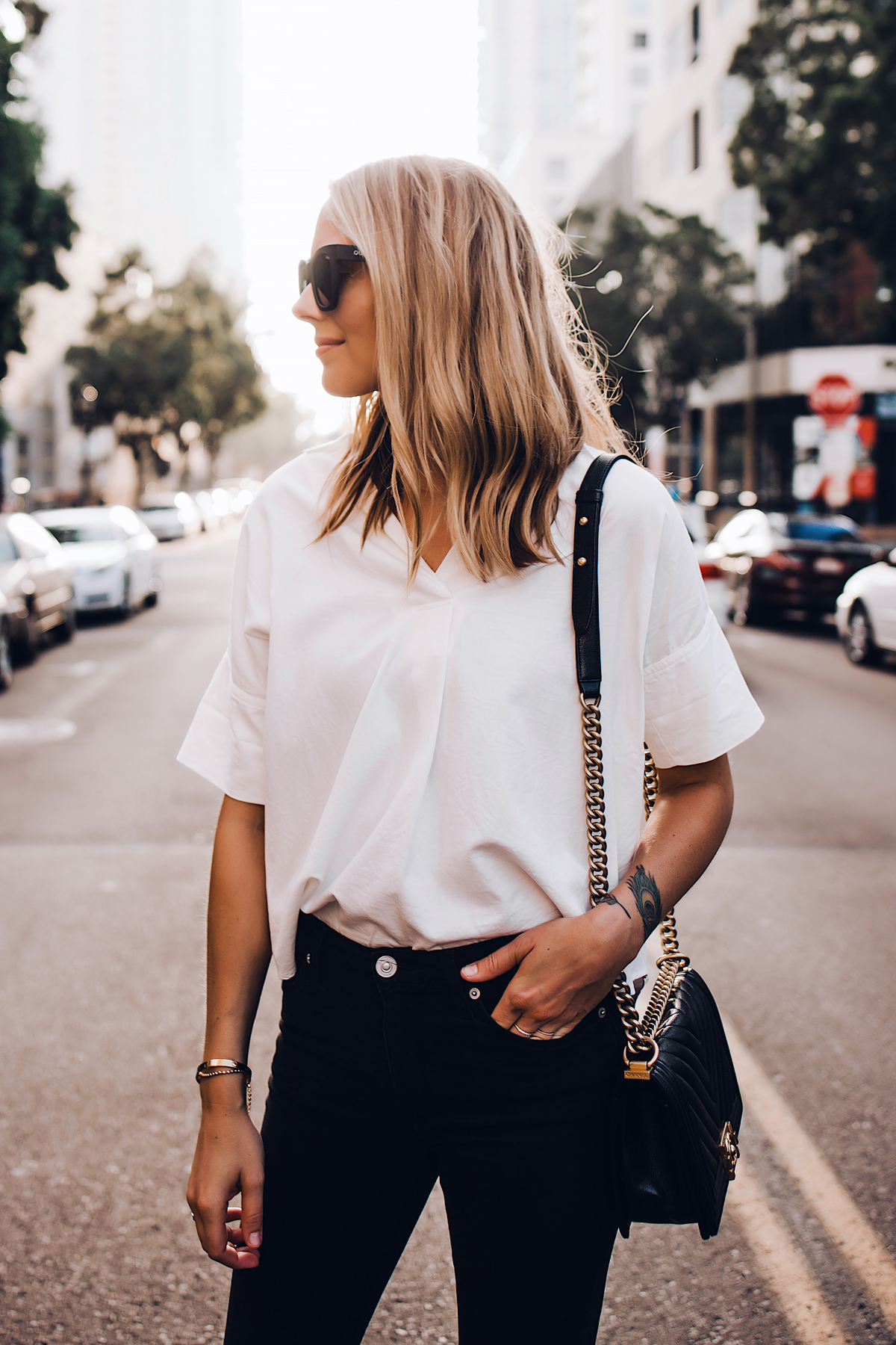 Blonde Woman Wearing Madewell Short Sleeve White Shirt Black Jeans Chanel Boy Bag Black Fashion Jackson San Diego Fashion Blogger Street Style
