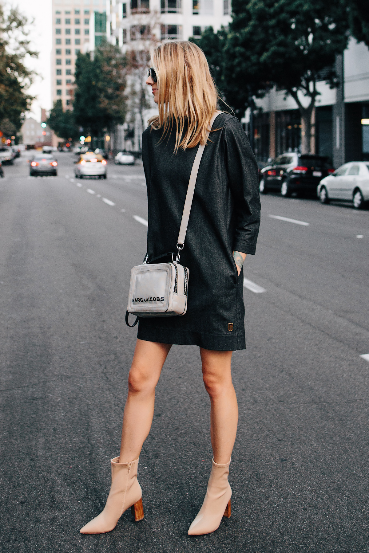 Blonde Woman Wearing Fashion Jackson Marc Jacobs Box Bag Marc Jacobs Denim Shift Dress Tan Heeled Booties Fashion Jackson San Diego Fashion blogger Street Style