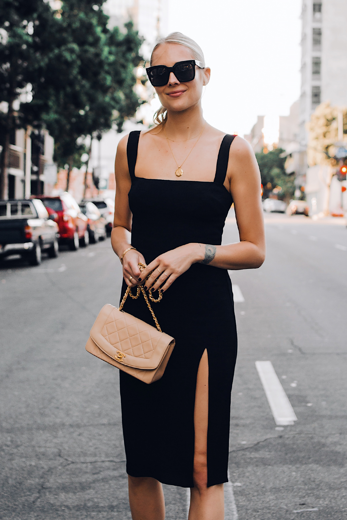 Blonde Woman Wearing Reformation Black Dress Chanel Tan Diana Handbag Gold Coin Necklace Black Celine Tilda Sunglasses Fashion Jackson San Diego Fashion Blogger Street Style