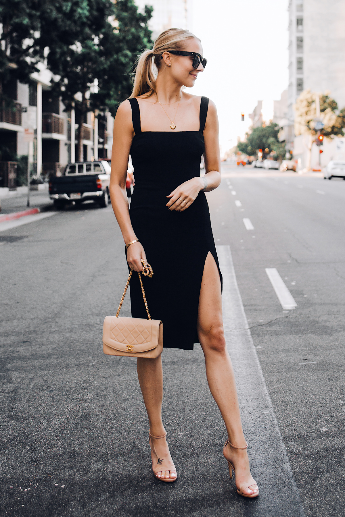 Blonde Woman Wearing Reformation Black Dress Tan Ankle Strap Heeled Sandals Chanel Tan Diana Handbag Gold Coin Necklace Black Celine Tilda Sunglasses Fashion Jackson San Diego Fashion Blogger Street Style