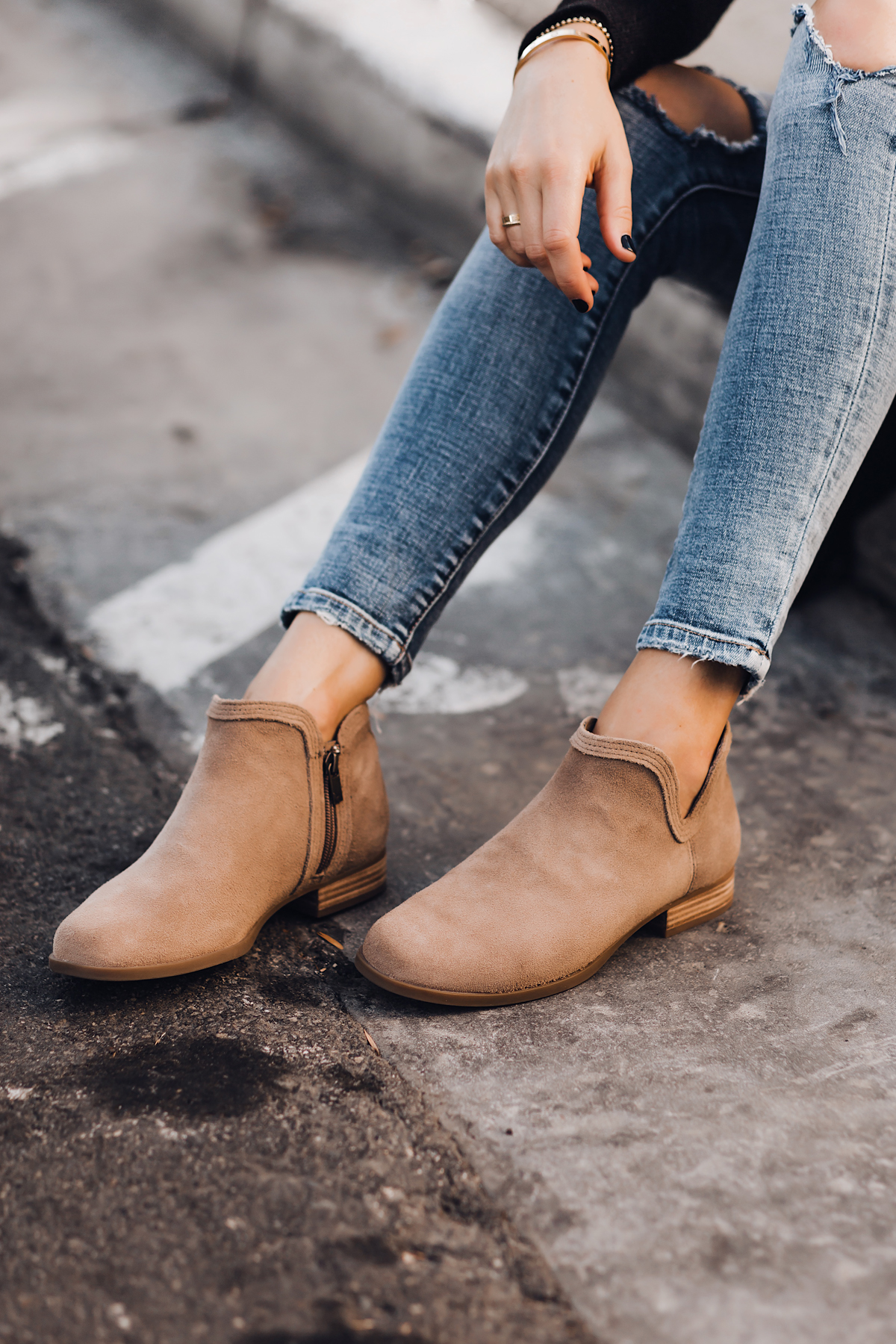 Woman Wearing Ripped Skinny Jeans Uggs Koolaburra Tan Booties Fashion Jackson San Diego Fashion Blogger Street Style