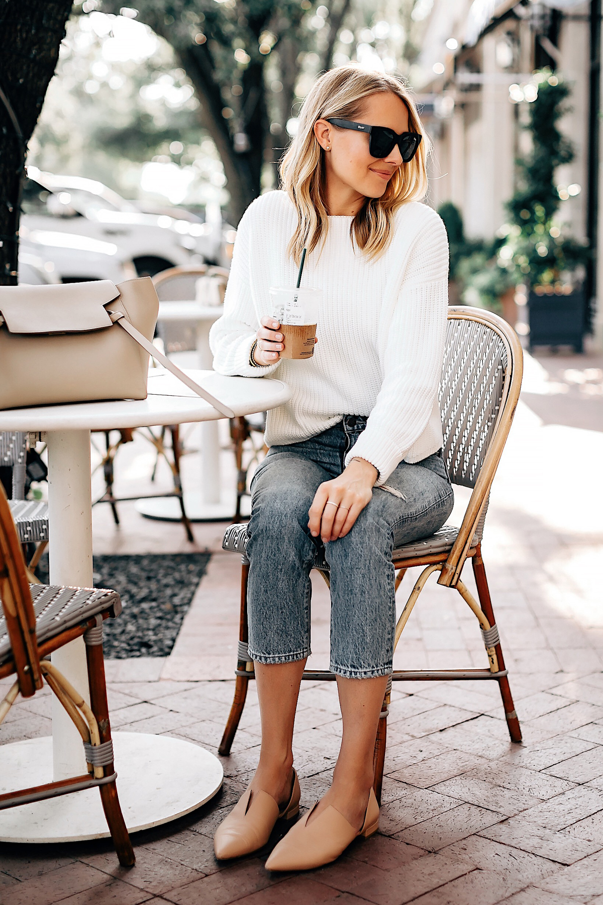 Blonde Woman Wearing Wearing White Sweater Jeans Blush Flats Drinking Coffee at a Cafe San Diego Fashion Blogger