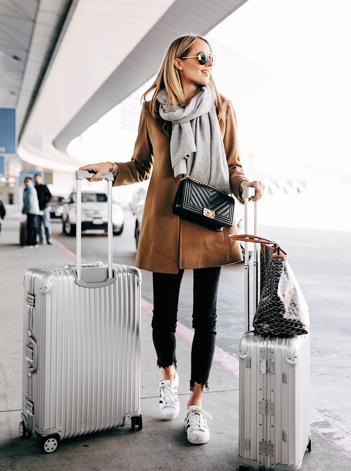 Blonde Woman with Rimowa Luggage at Airport Fashion Jackson
