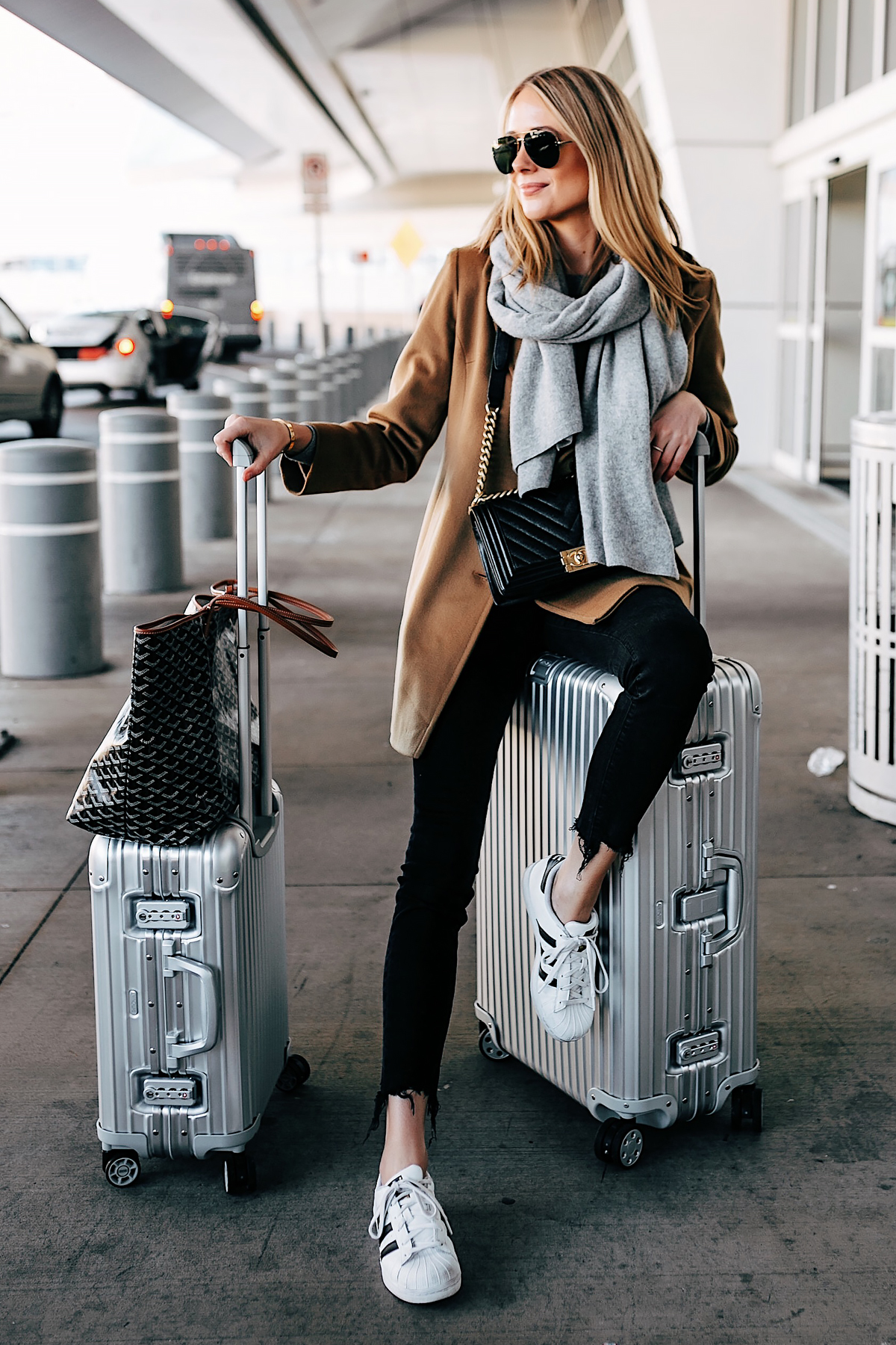 Blonde Woman Airport Travel Style Rimowa Luggage Goyard Tote