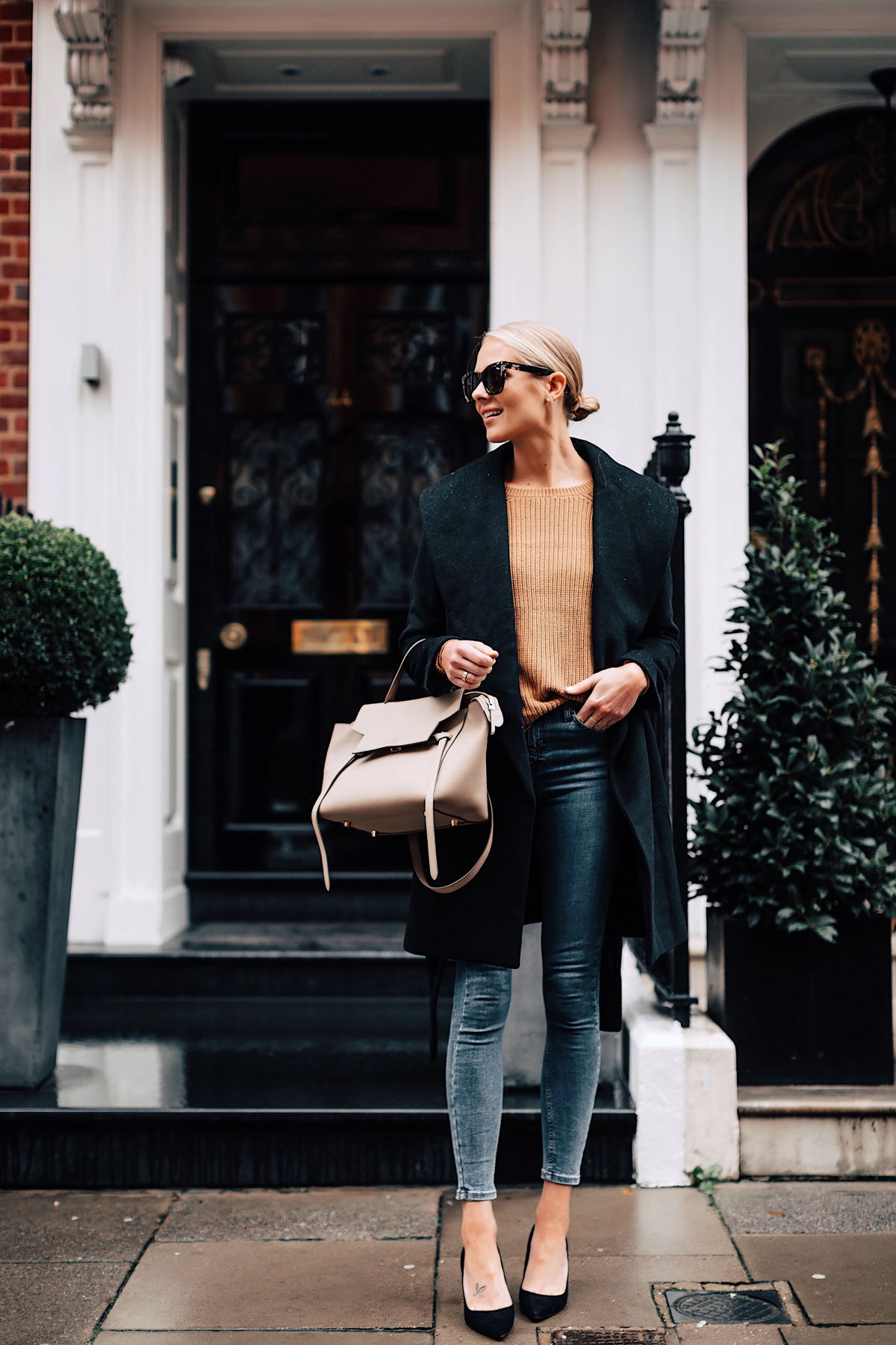 Blonde Woman Wearing Ann Taylor Black Wrap Coat Camel Sweater Denim Skinny Jeans Outfit Black Pumps Celine Mini Belt Bag Fashion Jackson San Diego Fashion Blogger London Street Style