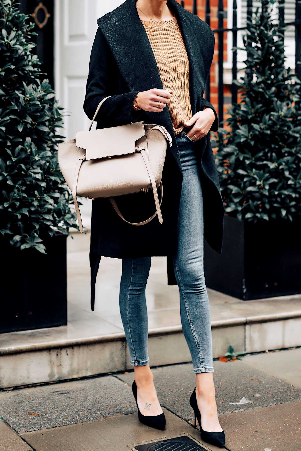 Woman Wearing Ann Taylor Black Wrap Coat Camel Sweater Denim Skinny Jeans Outfit Black Pumps Celine Mini Belt Bag Fashion Jackson San Diego Fashion Blogger London Street Style