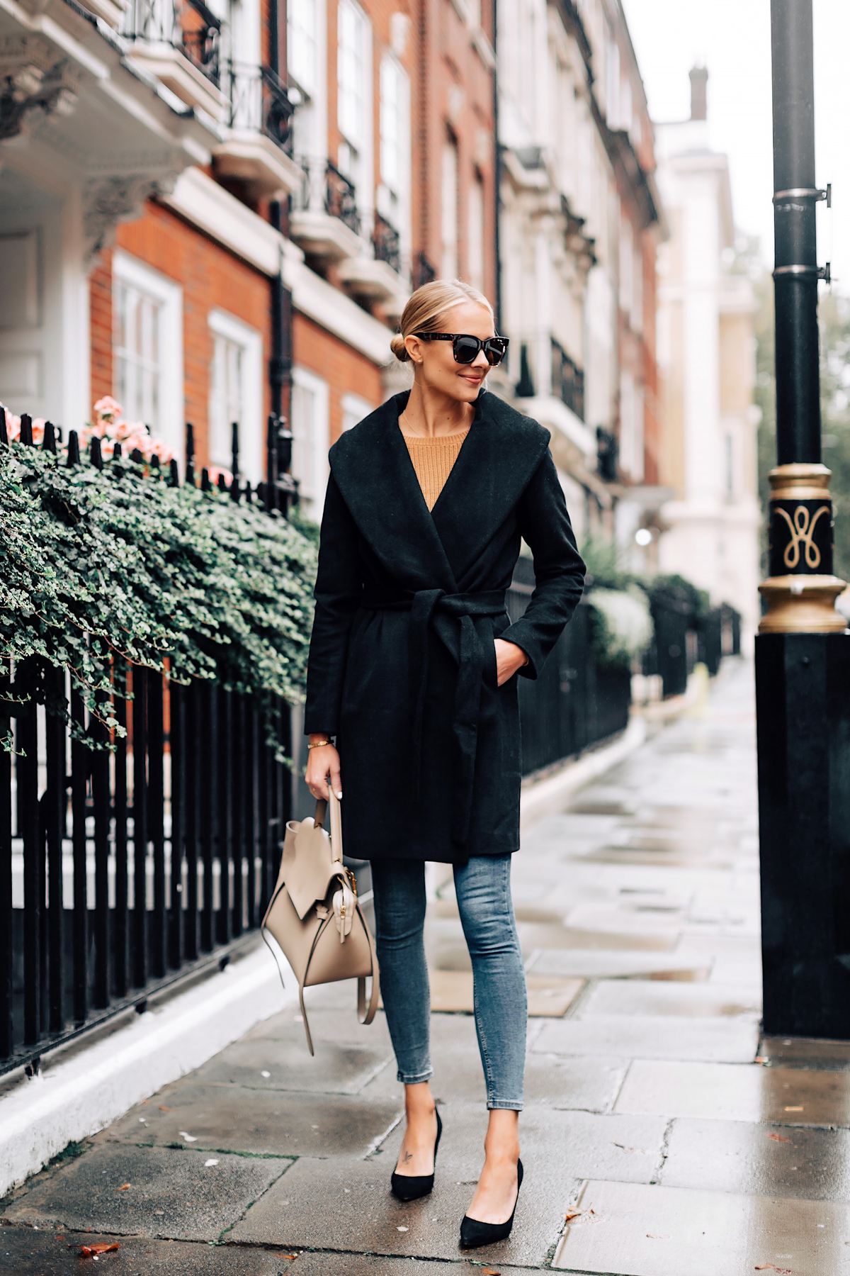 Blonde Woman Wearing Ann Taylor Black Wrap Coat Camel Sweater Denim Skinny Jeans Outfit Black Pumps Fashion Jackson San Diego Fashion Blogger London Street Style