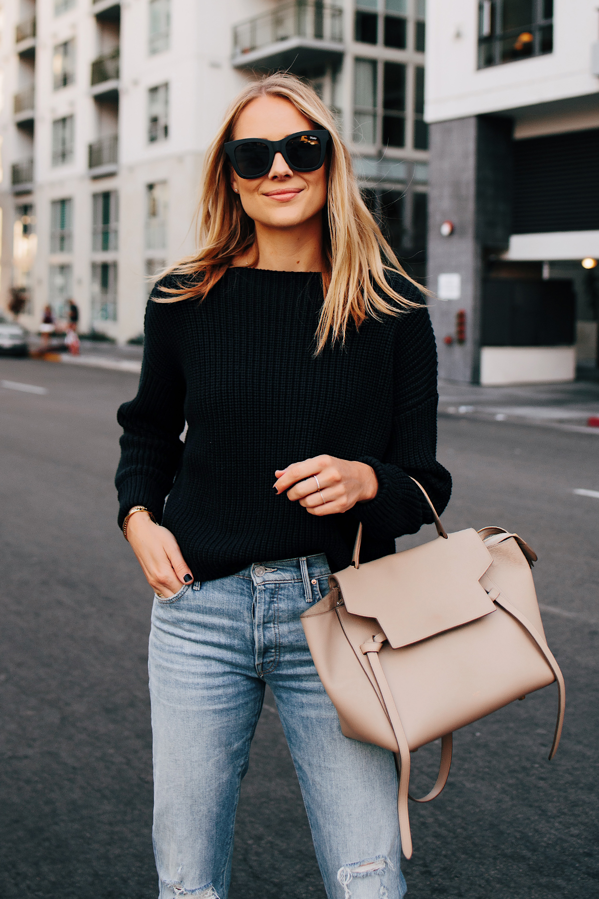 Blonde Woman Wearing Black Chunky Sweater Ripped Jeans Celine Mini Belt Bag Taupe Fashion Jackson San Diego Fashion Blogger Street Style