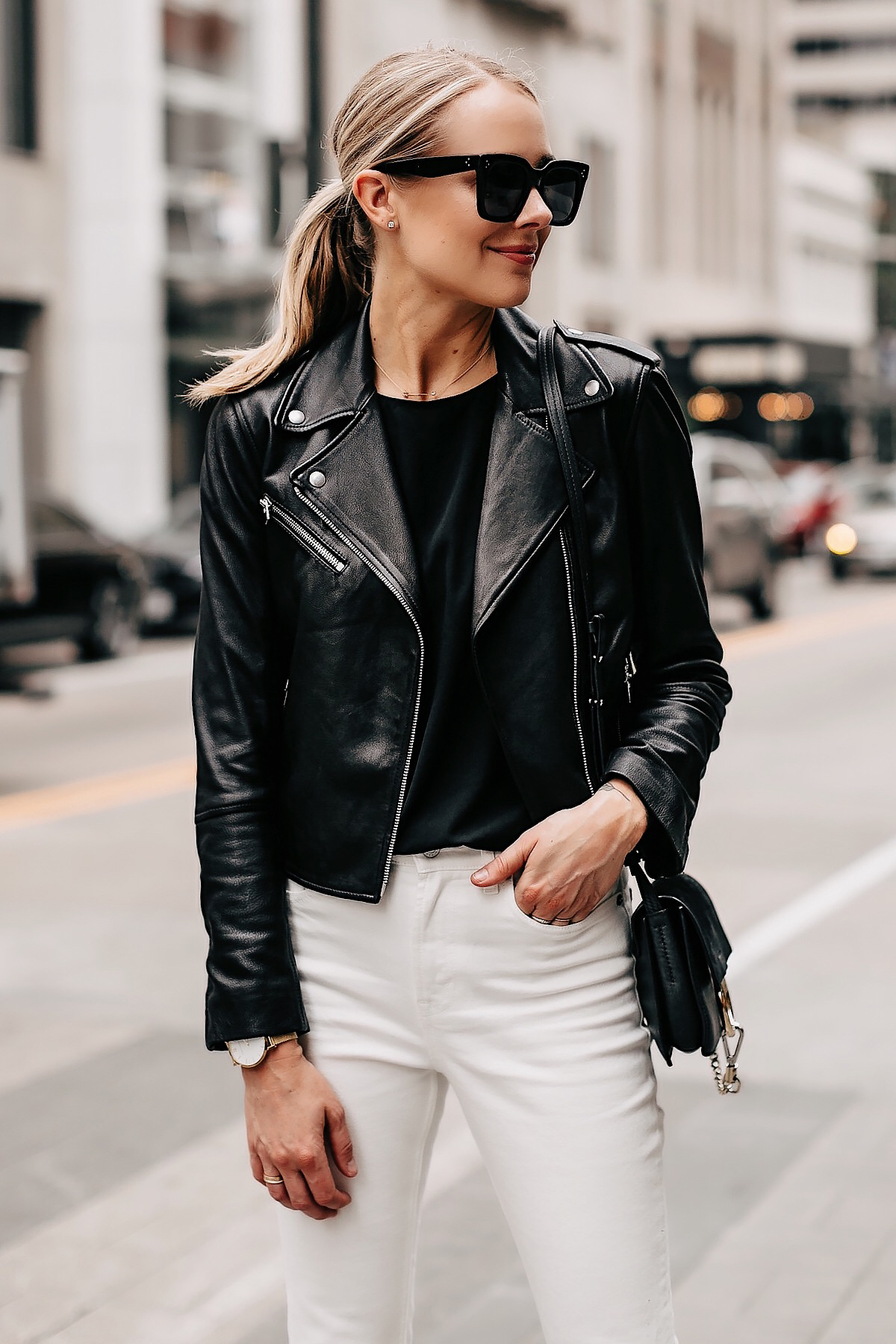 Blonde Woman Wearing Black Leather Jacket Black Top White Cropped Jeans Chloe Faye Black Handbag Fashion Jackson San Diego Fashion Blogger Street Style