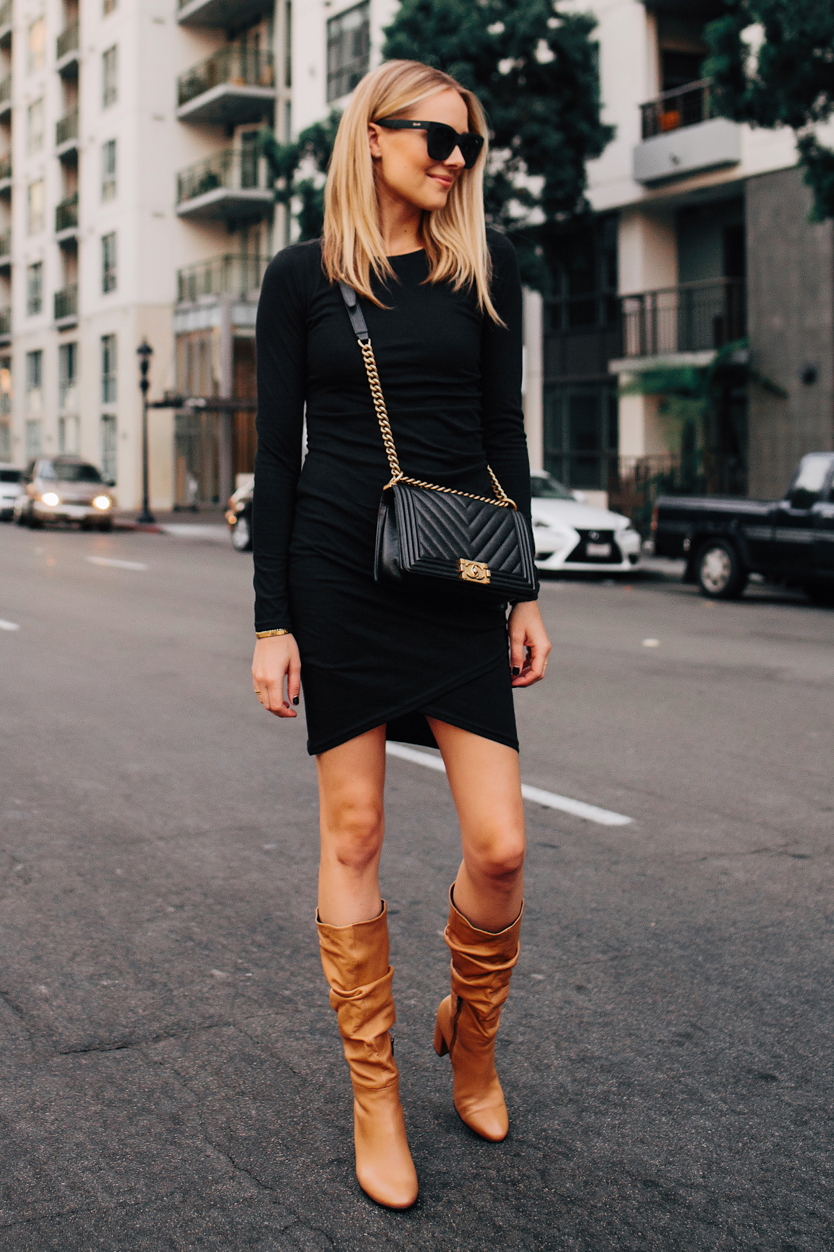Blonde Woman Wearing Black Long Sleeve Bodycon Dress Ecco Tan Leather Heeled Boots Chanel Black Boy Bag Fashion Jackson San Diego Fashion Blogger Street Style