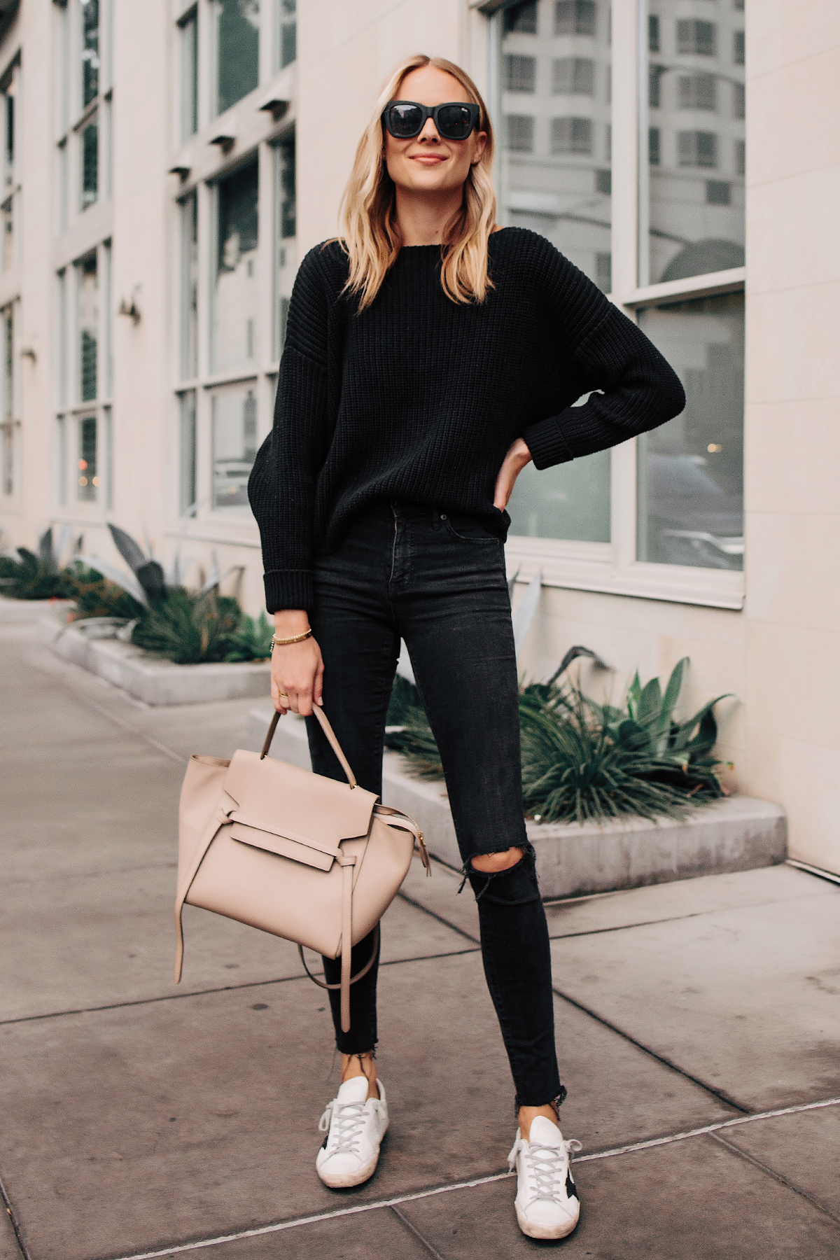 Blonde Woman Wearing Black Oversized Sweater Madewell Black Ripped Skinny Jeans Golden Goose Sneakers Celine Mini Belt Bag Fashion Jackson San Diego Fashion Blogger Street Style