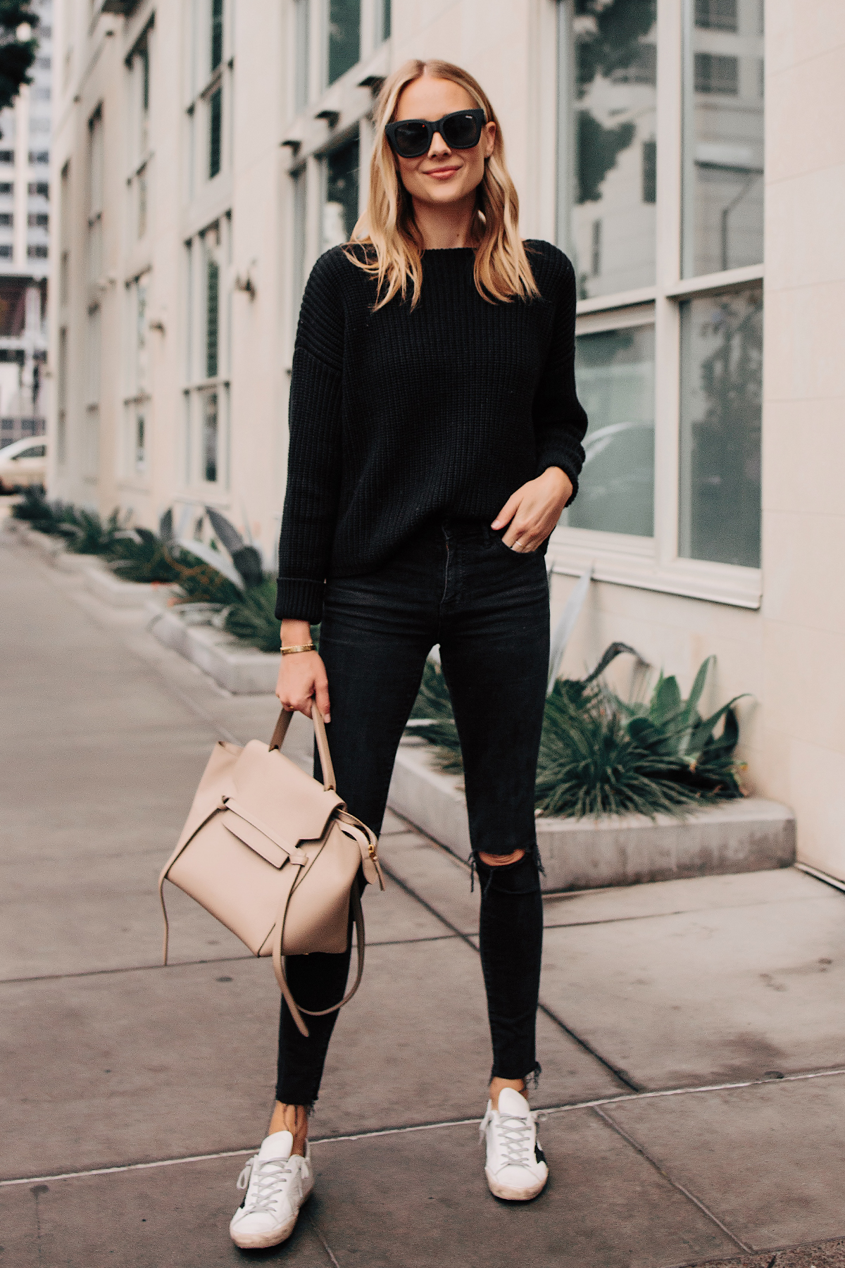 Blonde Woman Wearing Black Oversized Sweater Madewell Black Ripped Skinny Jeans Outfit Golden Goose Sneakers Celine Mini Belt Bag Fashion Jackson San Diego Fashion Blogger Street Style
