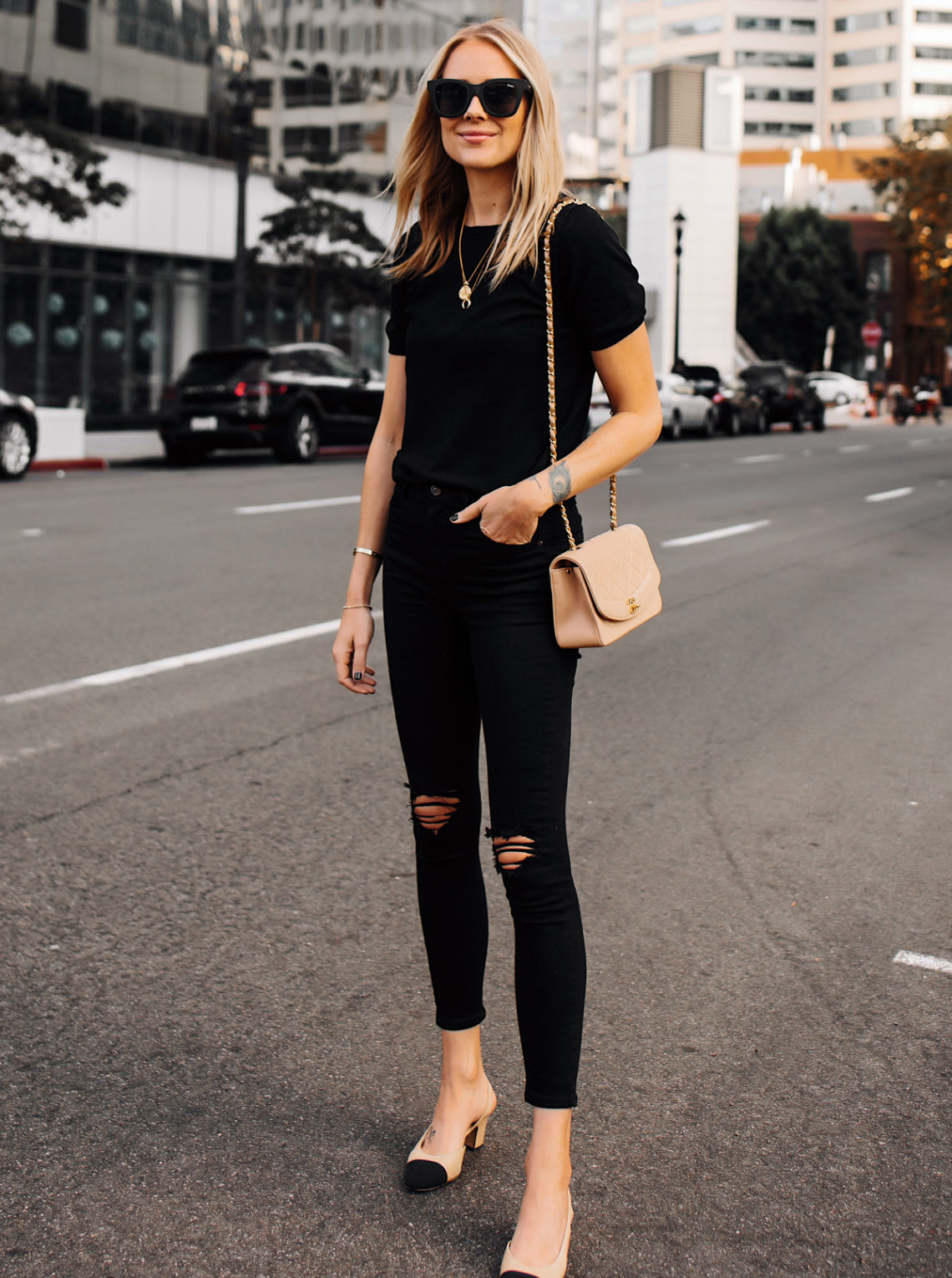 Blonde Woman Wearing Black Short Sleeve Top Black Ripped Skinny Jeans Chanel Diana Tan Handbag Chanel Slingback Shoes Fashion Jackson San Diego Fashion Blogger Street Style