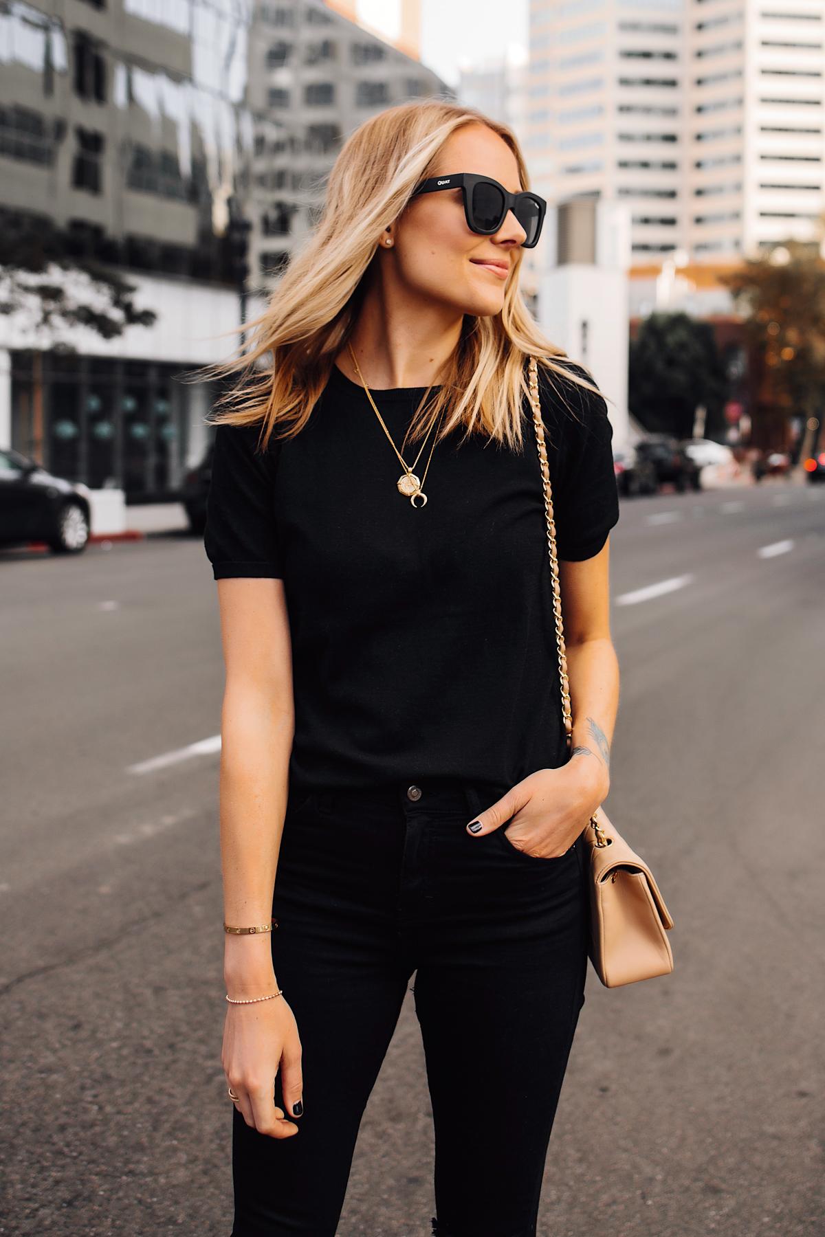 Blonde Woman Wearing Black Short Sleeve Top Black Ripped Skinny Jeans Chanel Diana Tan Handbag Gold Missoma Necklaces Fashion Jackson San Diego Fashion Blogger Street Style