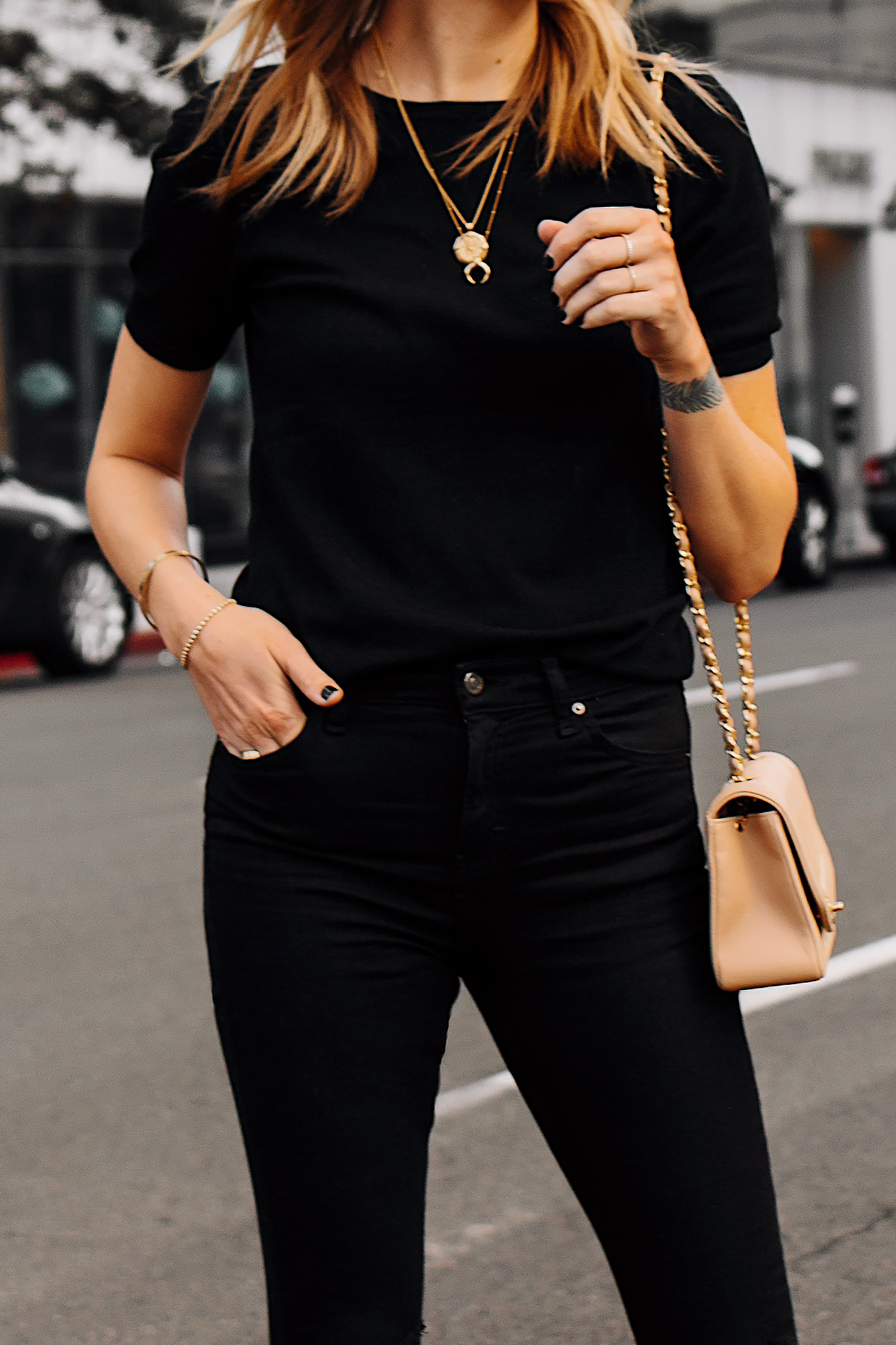 Woman Wearing Black Short Sleeve Top Black Ripped Skinny Jeans Gold Missoma Necklaces Fashion Jackson San Diego Fashion Blogger Street Style