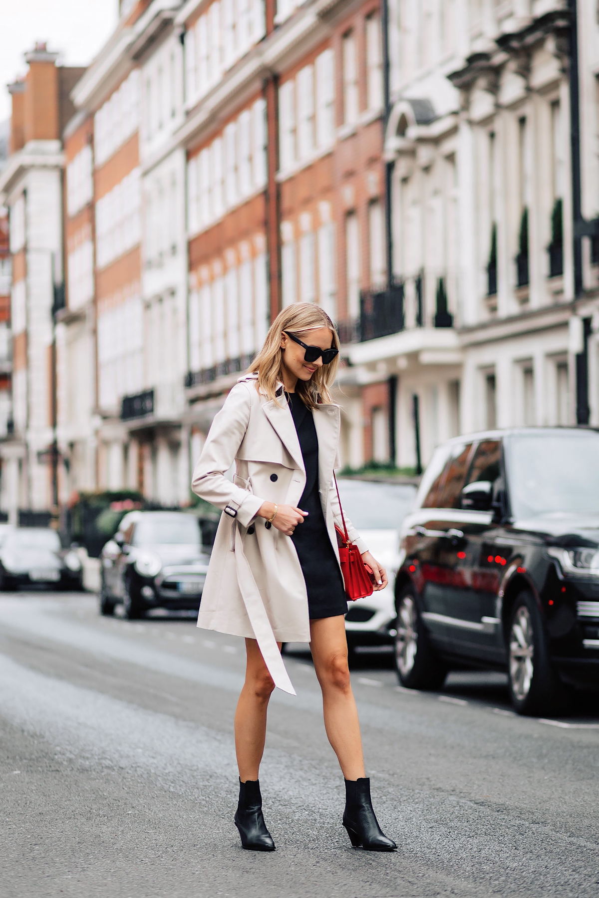 Blonde Woman Wearing Club Monaco Trench Coat Black Dress Black Booties Outfit Red Handbag Fashion Jackson San Diego Fashion Blogger London Street Style