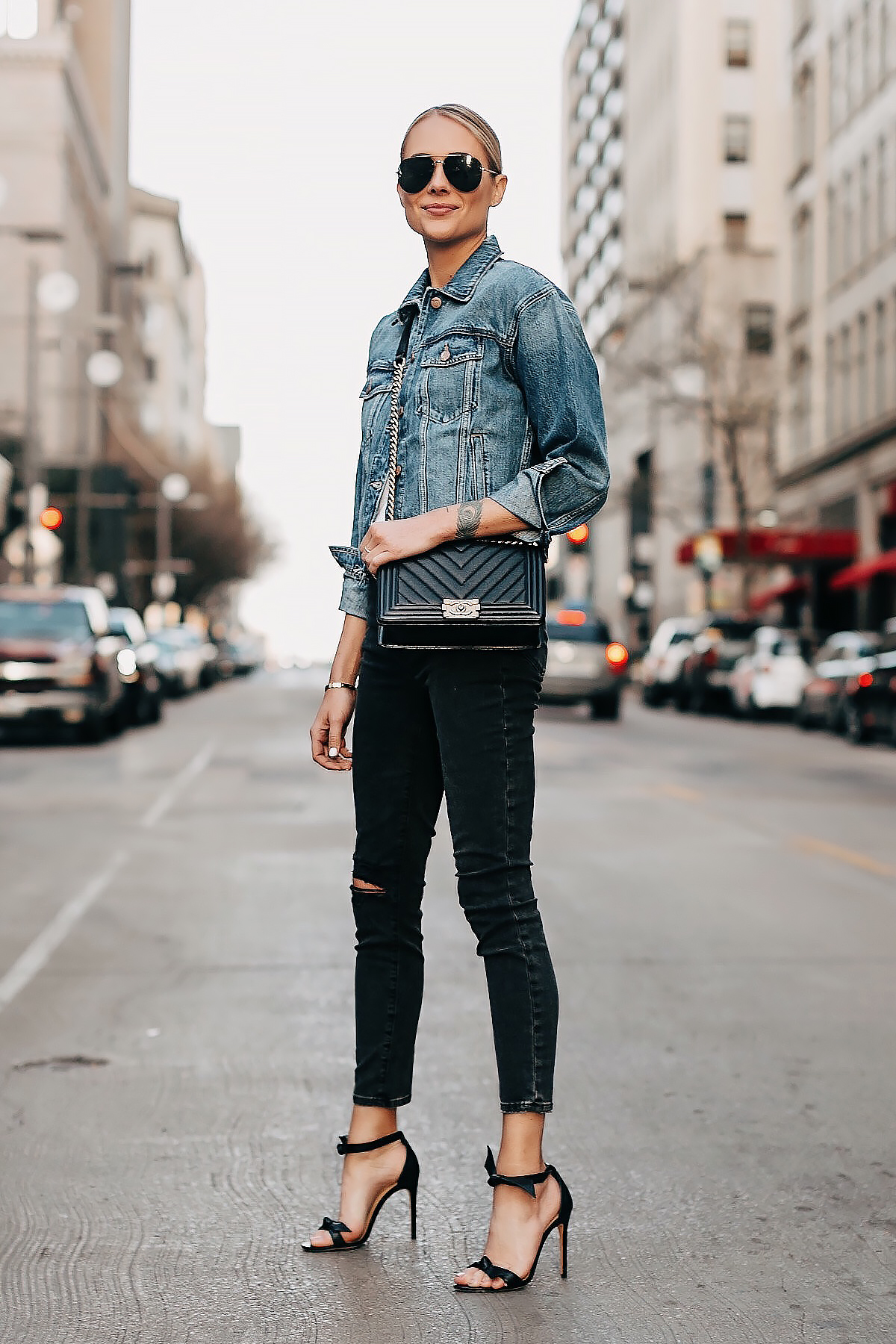 Blonde Woman Wearing Denim Jacket Black Ripped Skinny Jeans Black Heeled Sandals Chanel Black Boy Bag Fashion Jackson San Diego Fashion Blogger Street Style