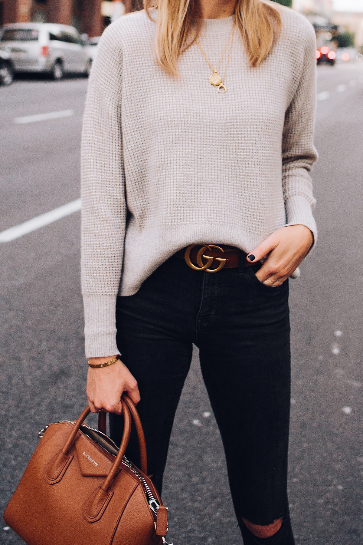Woman Wearing Everlane Taupe Cashmere Sweater Black Ripped Skinny Jeans Brown Gucci Logo Belt Black Booties Givenchy Anitogona Cognac Handbag Gold Layered Necklaces Fashion Jackson San Diego Fashion Blogger Street Style