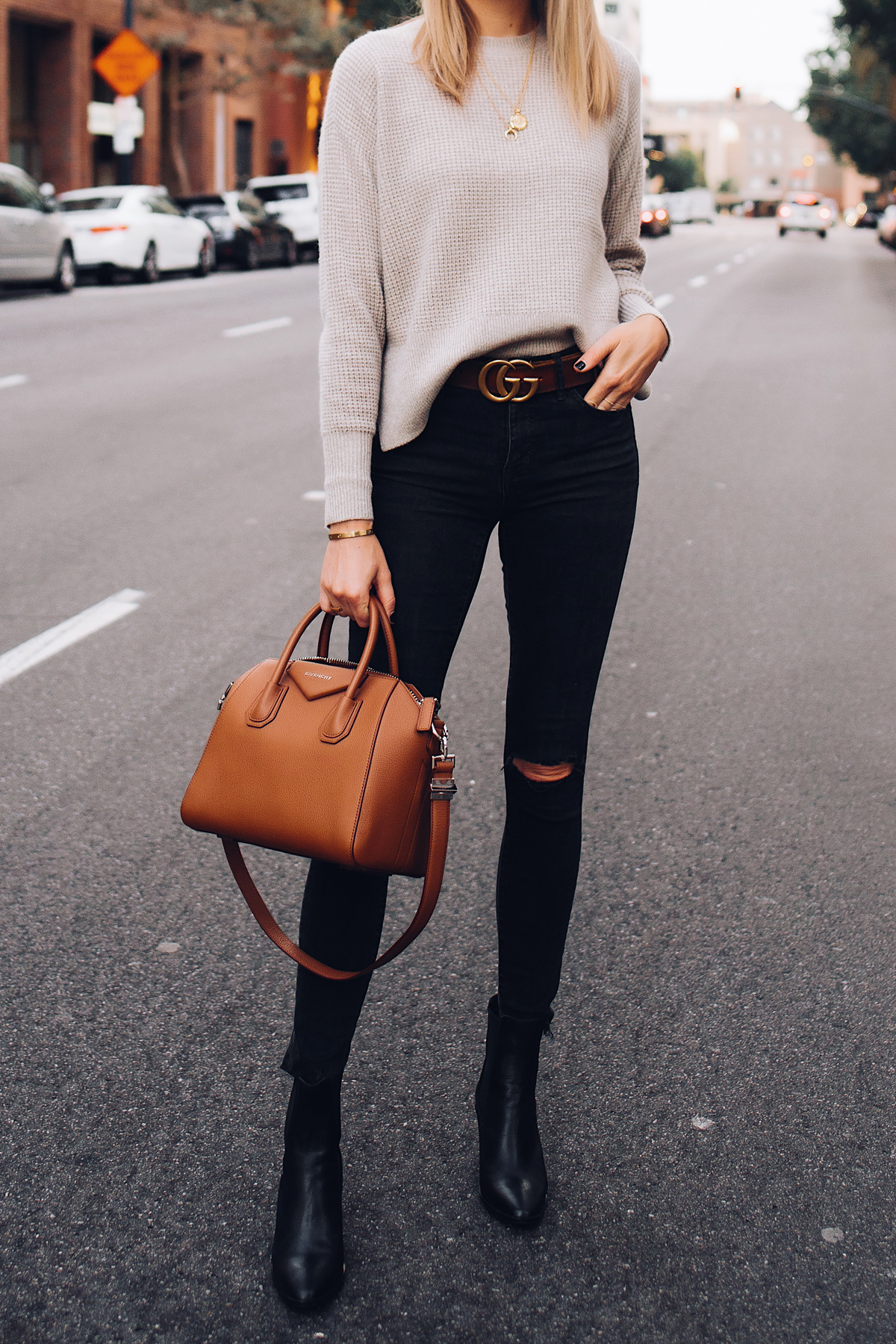 Woman Wearing Everlane Taupe Cashmere Sweater Black Ripped Skinny Jeans Brown Gucci Logo Belt Black Booties Givenchy Anitogona Cognac Handbag Fashion Jackson San Diego Fashion Blogger Street Style