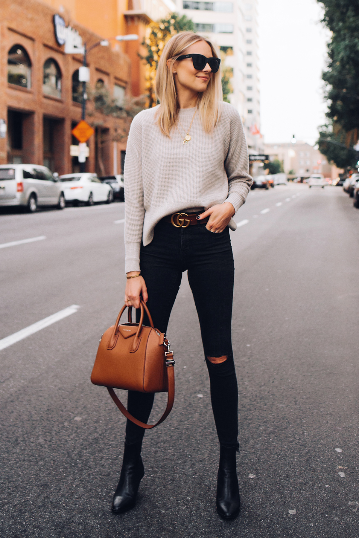 Blonde Woman Wearing Everlane Taupe Cashmere Sweater Black Ripped Skinny Jeans Brown Gucci Logo Belt Black Booties Givenchy Antigona Cognac Handbag Fashion Jackson San Diego Fashion Blogger Street Style