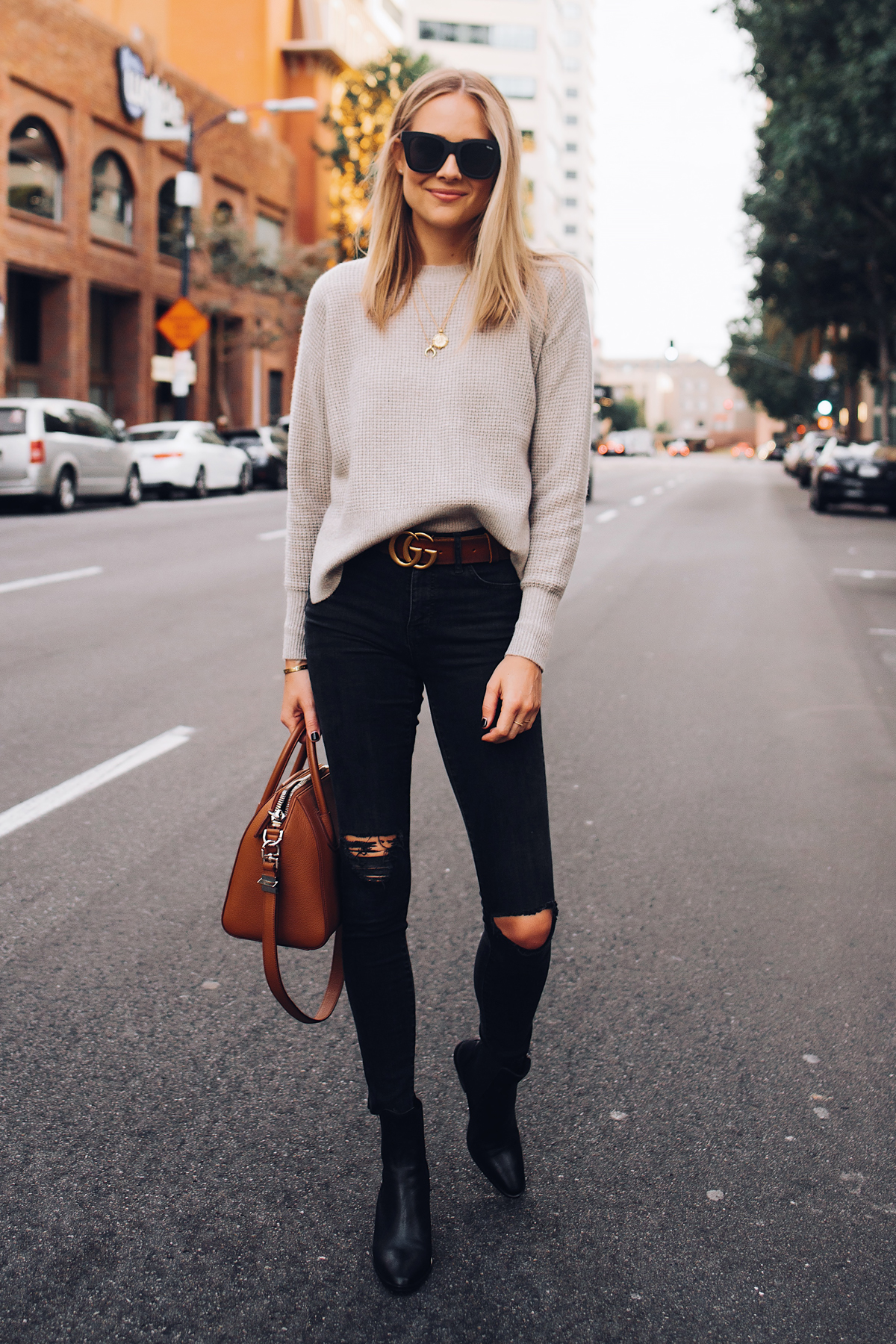 Blonde Woman Wearing Everlane Taupe Cashmere Sweater Black Ripped Skinny Jeans Brown Gucci Logo Belt Black Booties Tan Handbag Fashion Jackson San Diego Fashion Blogger Street Style