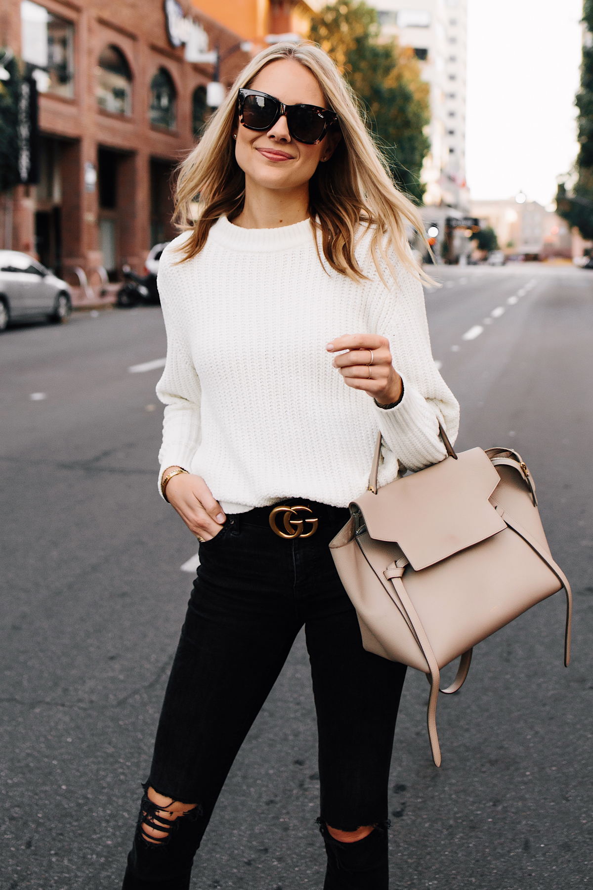 Blonde Woman Wearing Ivory Knit Sweater Black Ripped Jeans Black Gucci Logo Belt Celine Mini Belt Bag Taupe Fashion Jackson San Diego Fashion Blogger Street Style