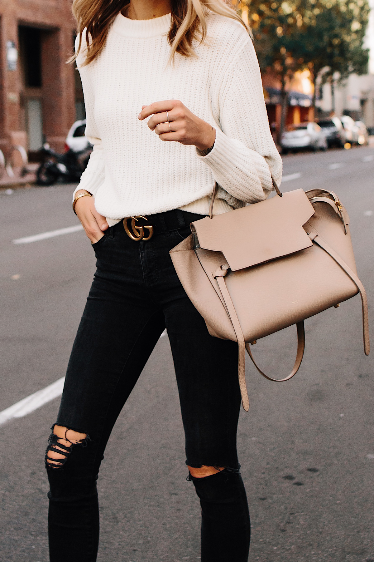 Woman Wearing Ivory Knit Sweater Black Ripped Skinny Jeans Black Gucci Logo Belt Celine Mini Belt Bag Fashion Jackson San Diego Fashion Blogger Street Style