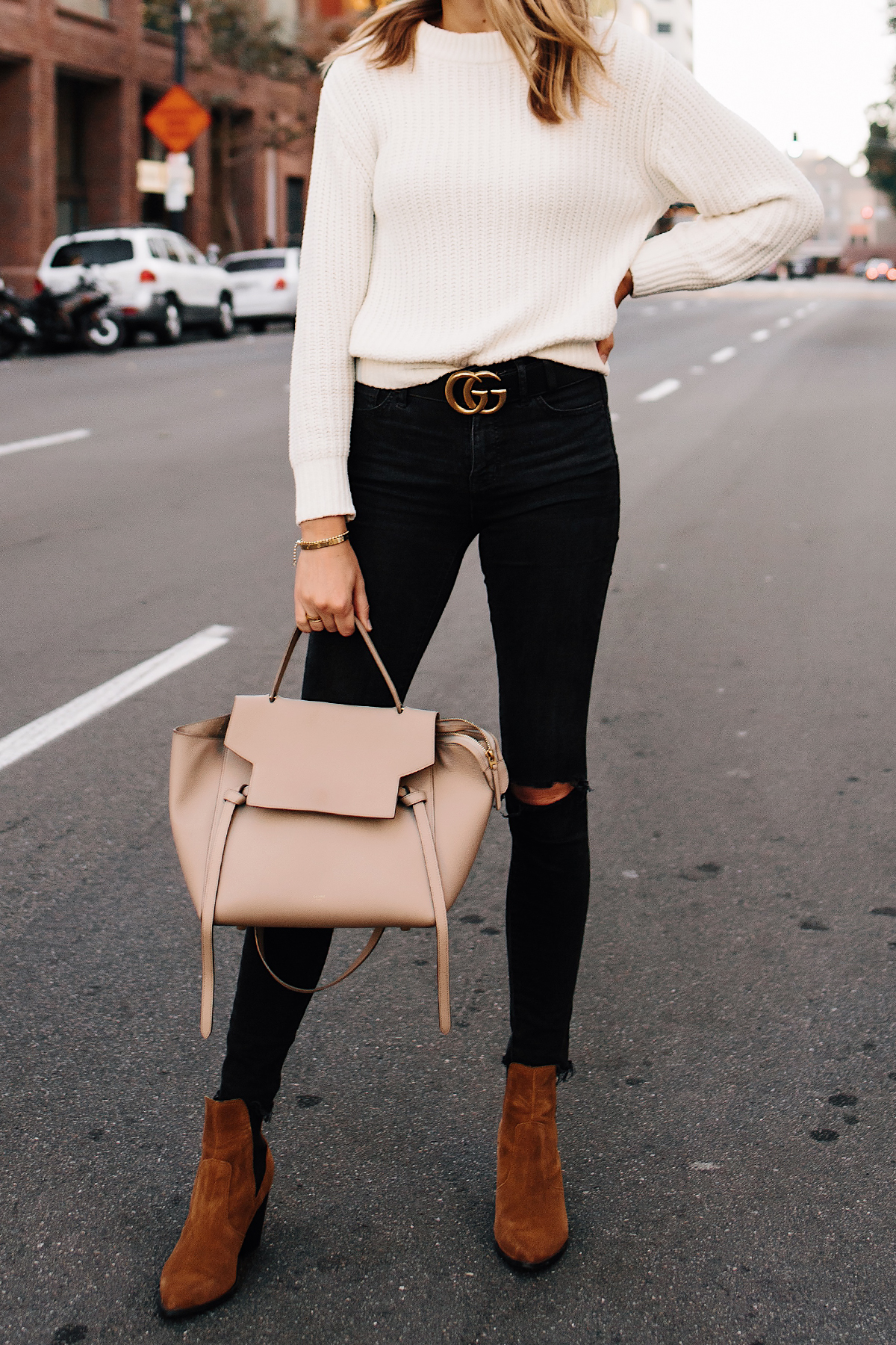 Woman Wearing Ivory Knit Sweater Madewell Black Ripped Jeans Gucci Logo Belt Steve Madden Brown Booties Celine Mini Belt Bag Fashion Jackson San Diego Fashion Blogger Street Style