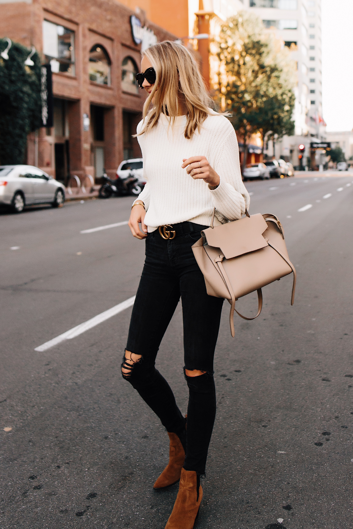 Blonde Woman Wearing Ivory Knit Sweater Madewell Black Ripped Jeans Gucci Logo Belt Steve Madden Brown Chelsea Booties Celine Mini Belt Bag Fashion Jackson San Diego Fashion Blogger Street Style