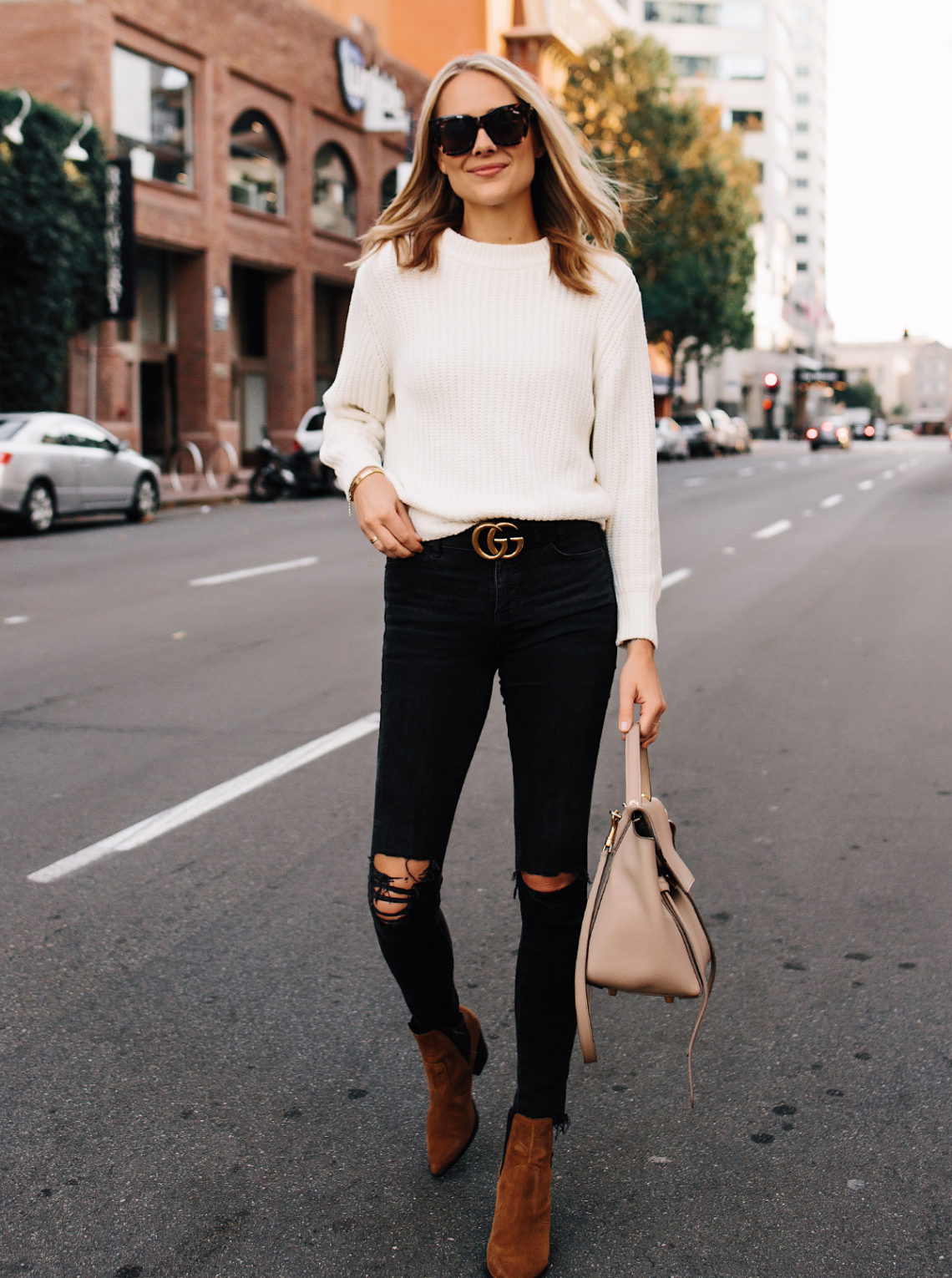 Blonde Woman Wearing Ivory Knit Sweater Madewell Black Ripped Jeans Gucci Logo Belt Steve Madden Brown Chelsea Booties Outfit Celine Mini Belt Bag Fashion Jackson San Diego Fashion Blogger Street Style