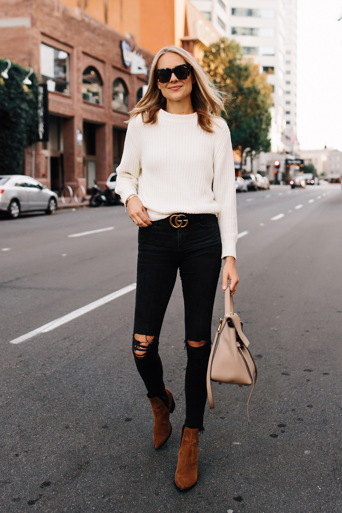 d4ab66b87ab Blonde Woman Wearing Ivory Knit Sweater Madewell Black Ripped Jeans Gucci  Logo Belt Steve Madden Brown