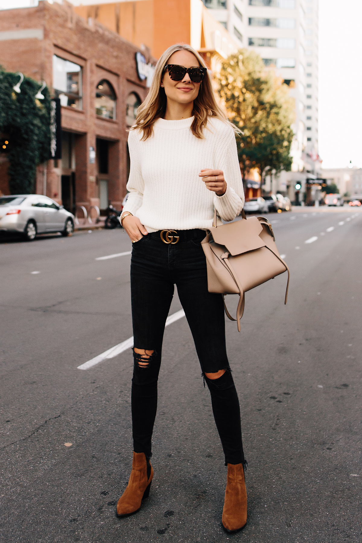 f807abbef Blonde Woman Wearing Ivory Knit Sweater Madewell Black Ripped Jeans Tan  Chelsea Booties Outfit Gucci Logo